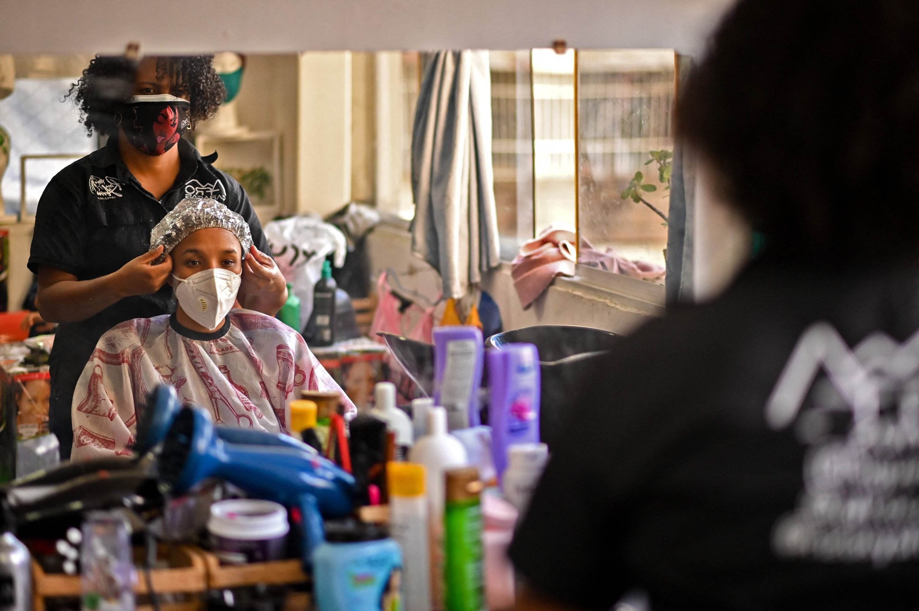 A customer prepares to get a haircut at a hairdresser's, in downtown Caracas, Venezuela, Sept. 1, 2021. (AFP Photo)
