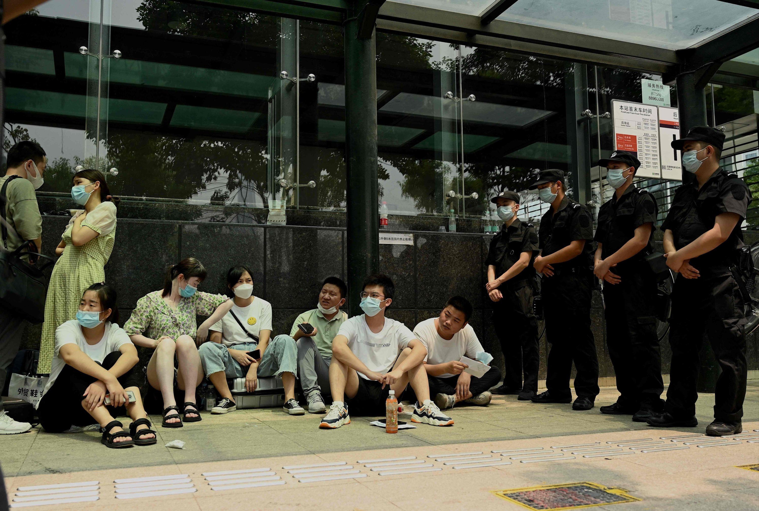 People gather at the Evergrande headquarters building in Shenzhen, southeastern China, Sept. 15, 2021. (AFP Photo)