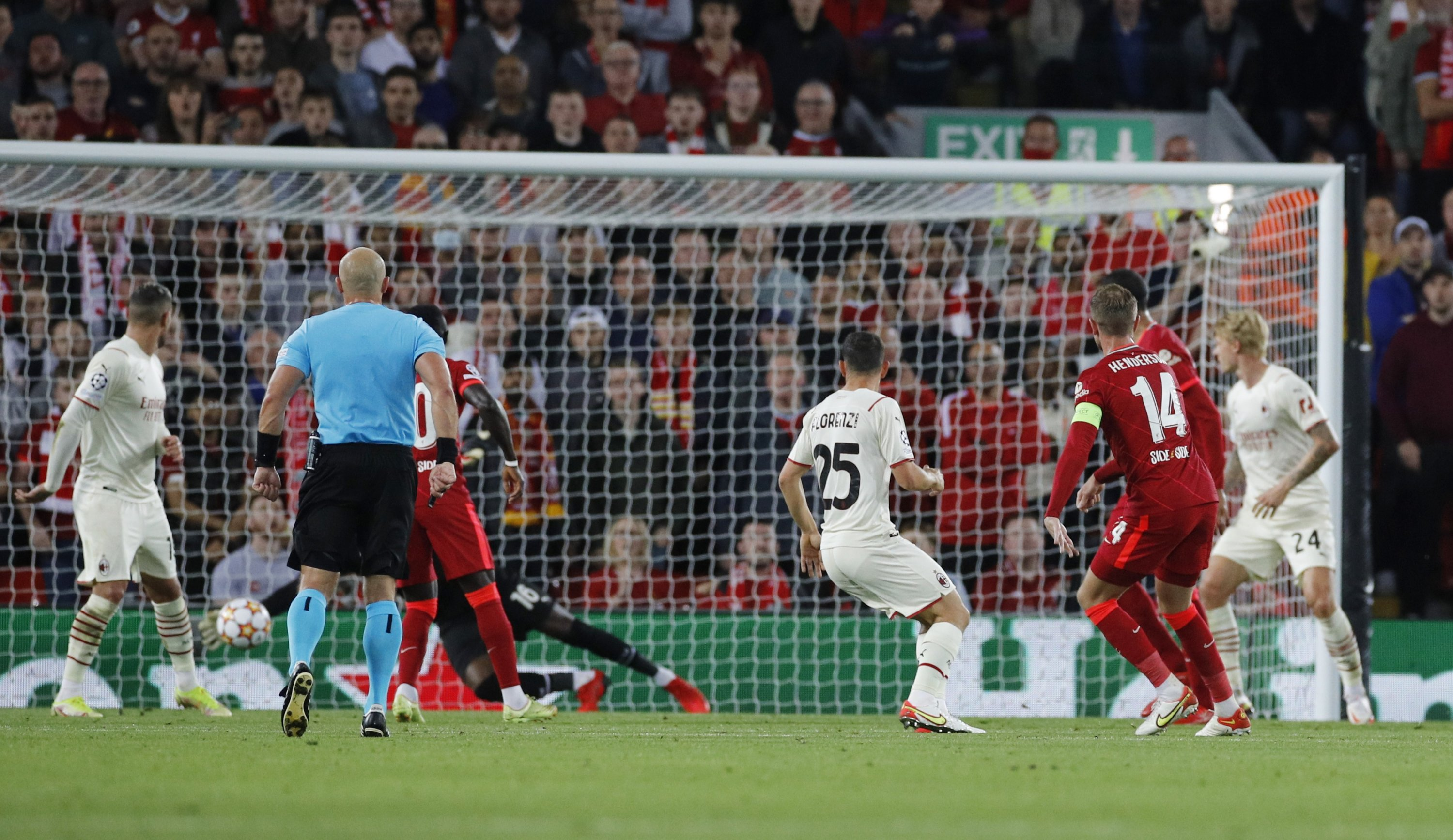 Liverpool's Jordan Henderson scores his team's third goal during the Champions League Group B football match between Liverpool and Milan at the Anfield, Liverpool, England, Sept. 15, 2021. (Reuters Photo)