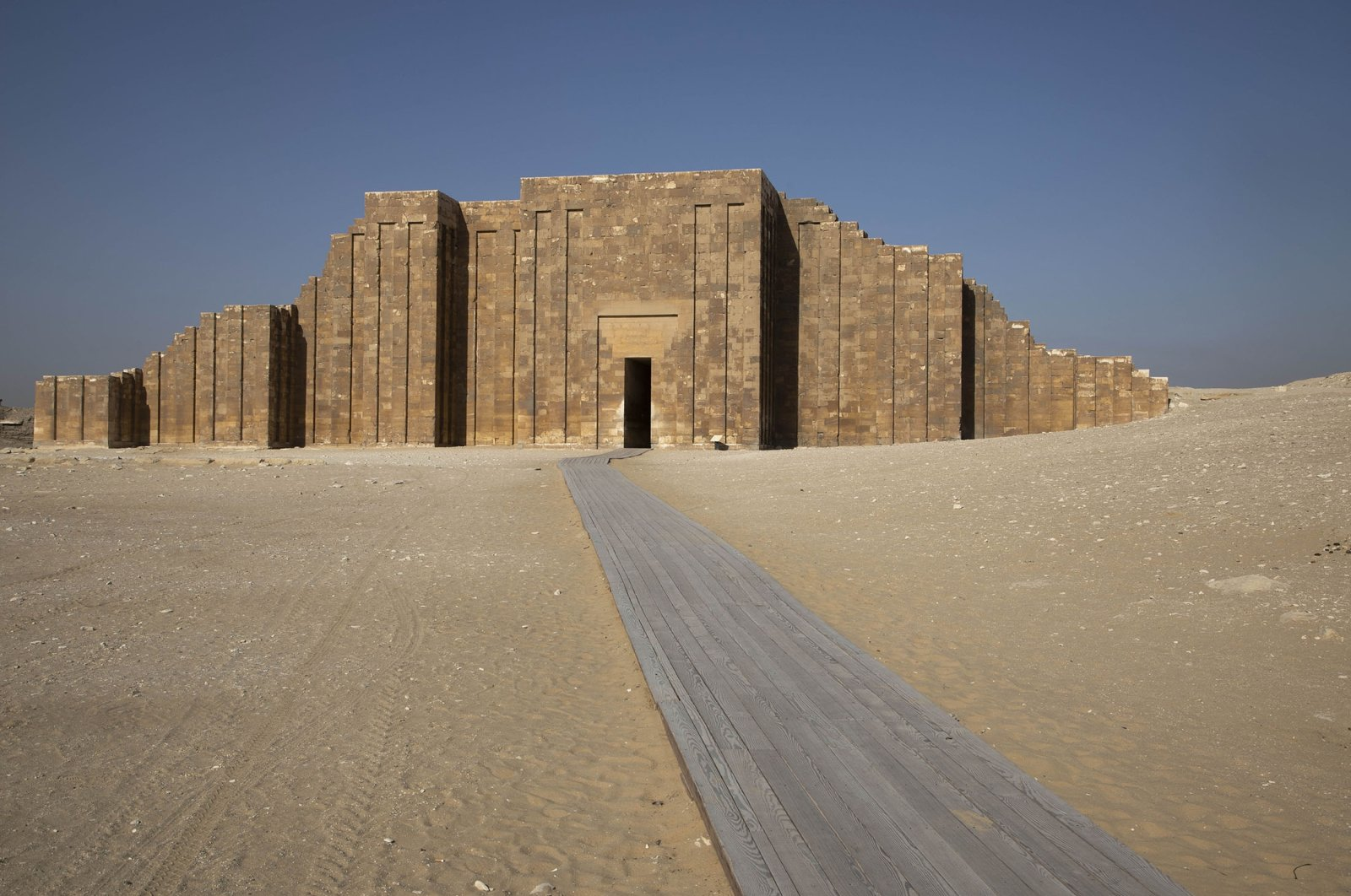 A path leads to the entrance of the southern cemetery of King Djoser, after its restoration, near the famed Step Pyramid, in Saqqara, south of Cairo, Egypt, Sept. 14, 2021. (AP Photo)