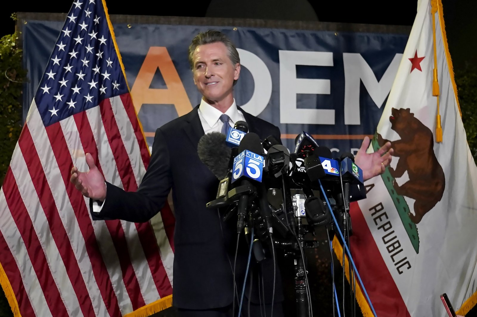 California Gov. Gavin Newsom addresses reporters after beating back the recall attempt that aimed to remove him from office, at the John L. Burton California Democratic Party headquarters in Sacramento, California, U.S., Sept. 14, 2021. (AP Photo)