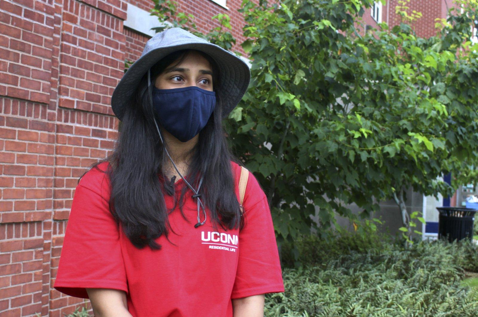 UConn sophomore Sahiti Bhyravavajhala assists students moving into Shippee Hall on campus, Storrs, Connecticut, U.S., Aug. 27, 2021. (AP Photo)