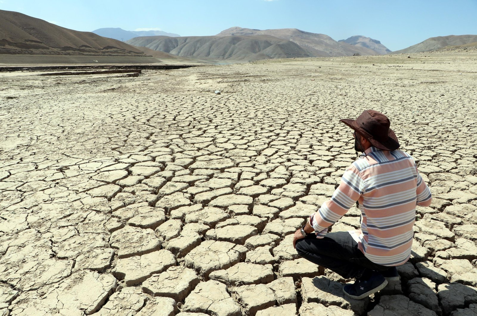 A man looks at a stretch of dried land in Van, eastern Turkey, Sept. 9, 2021. (DHA PHOTO)