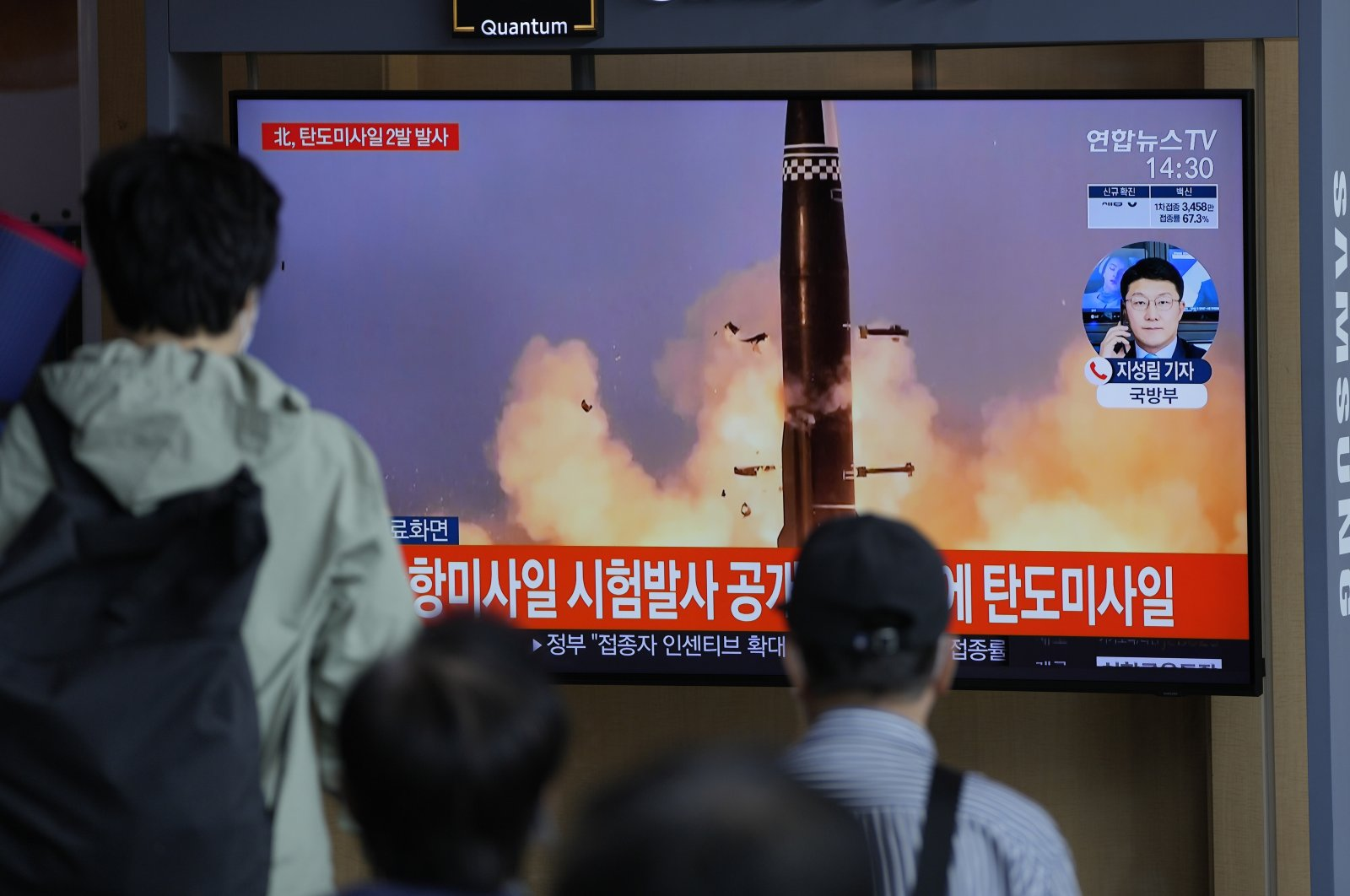 People watch a TV screen showing a news program reporting about North Korea's missiles with a file image in Seoul, South Korea, Sept. 15, 2021. (AP Photo)