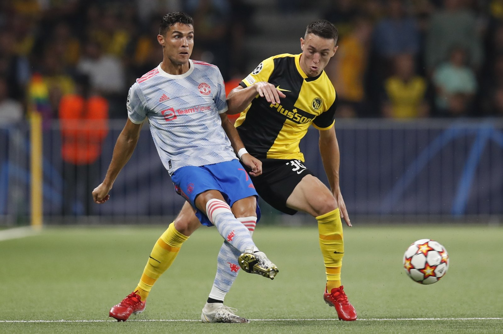 Young Boys' Silvan Hefti (R) and Manchester's Cristiano Ronaldo in action during their Champions League Group F match at the Wankdorf stadium in Bern, Switzerland, Sept. 14, 2021. (EPA Photo)
