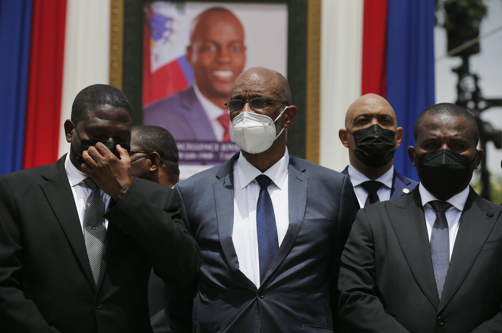 Haiti's designated Prime Minister Ariel Henry (C) and interim Prime Minister Claude Joseph (R) pose for a group photo with other authorities in front of a portrait of slain Haitian President Jovenel Moise at the National Pantheon Museum during a memorial service for Moise in Port-au-Prince, Haiti, July 20, 2021.(AP Photo)