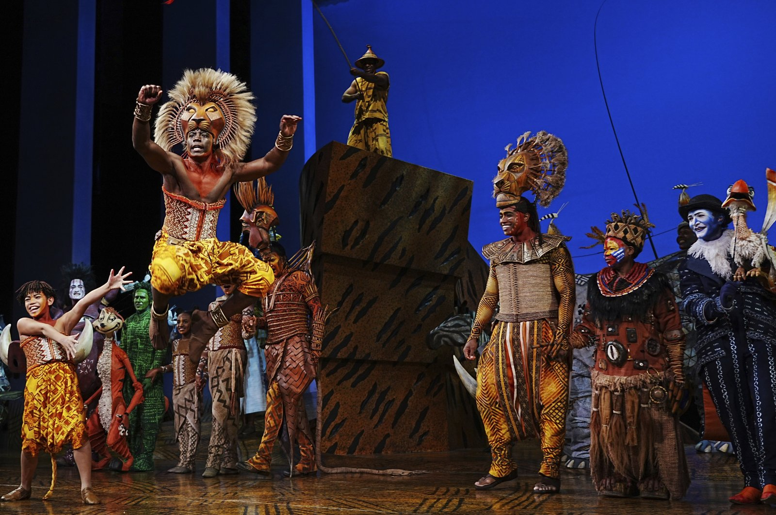 """""""The Lion King"""" cast appear at the curtain call following their first show back after the COVID-19 shutdown, at the Minskoff Theatre on Tuesday, Sept. 14, 2021, in New York. (AP Photo)"""