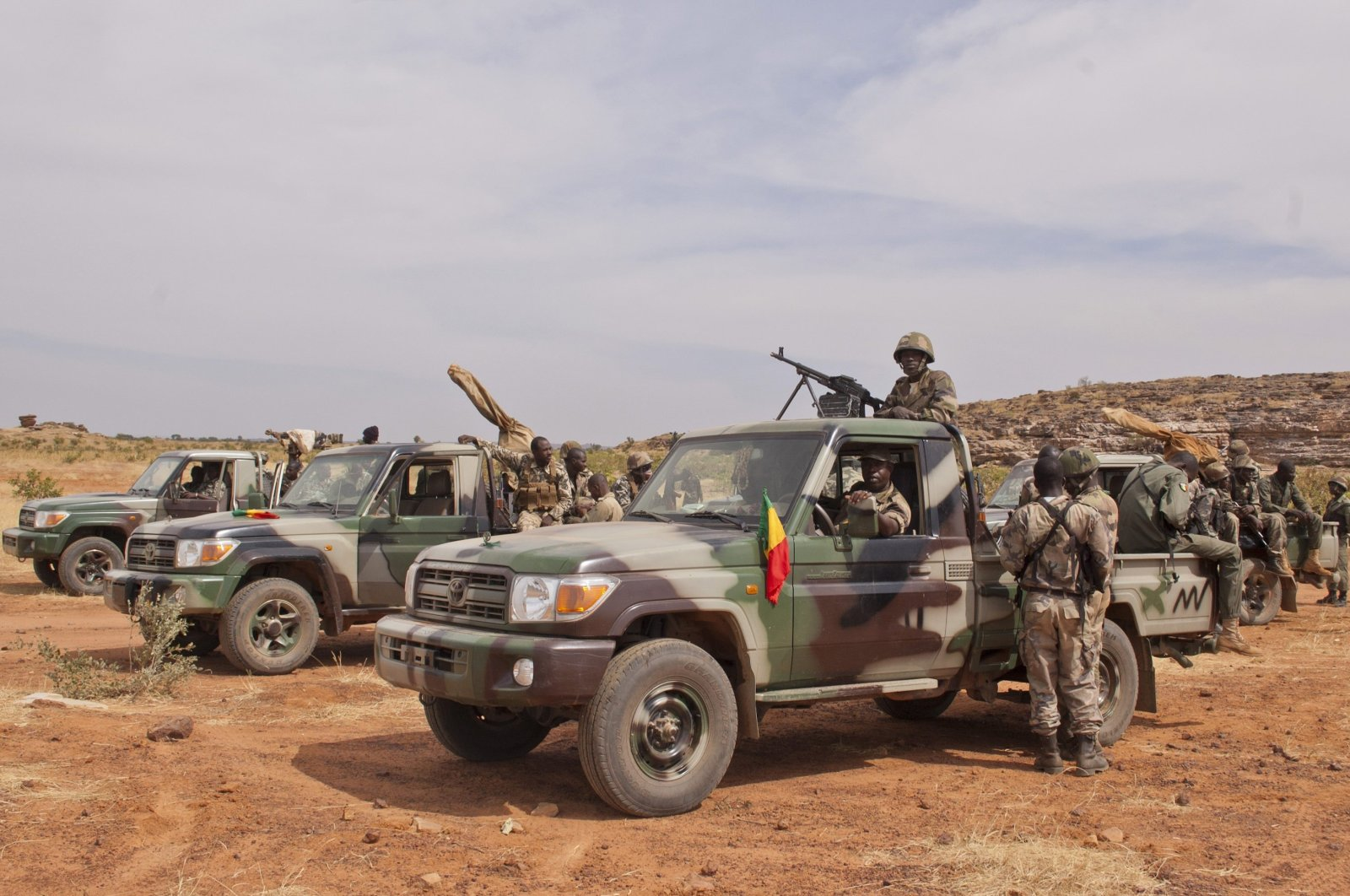 Soldiers from a Malian army special unit stand atop pick-ups mounted with machine guns, following a training exercise in the Barbe military zone, in Mopti, Mali, Nov. 24, 2012. (AP Photo)