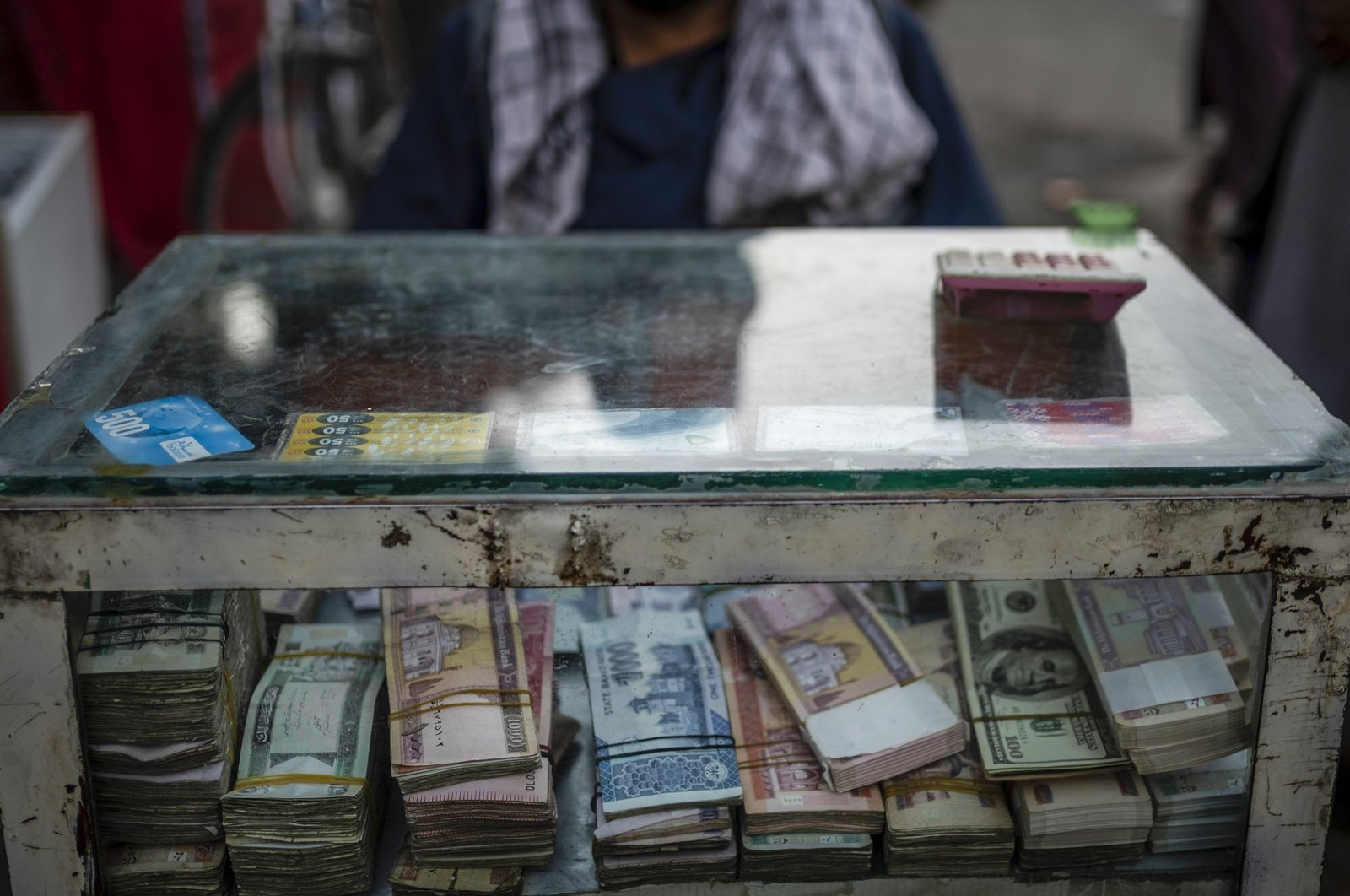 An Afghan money changer waits for customers in Kabul's Old City, Afghanistan, Sept. 14, 2021. (AP Photo)