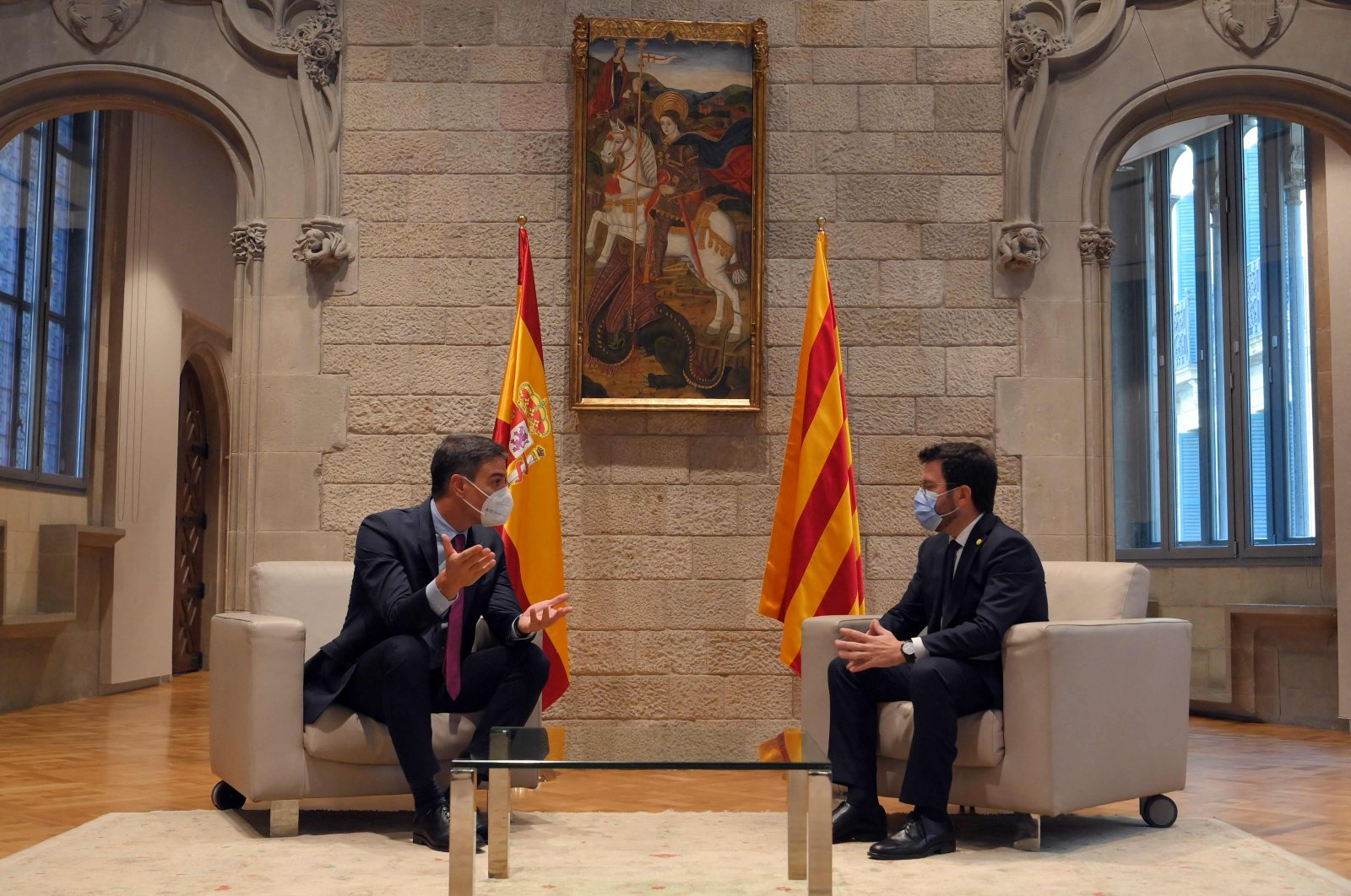 Spanish Prime Minister Pedro Sanchez (L) and Catalonian regional President Pere Aragones talk at the headquarters of the Government of Catalonia in Barcelona, Spain, Sept. 15, 2021. (AP Photo)