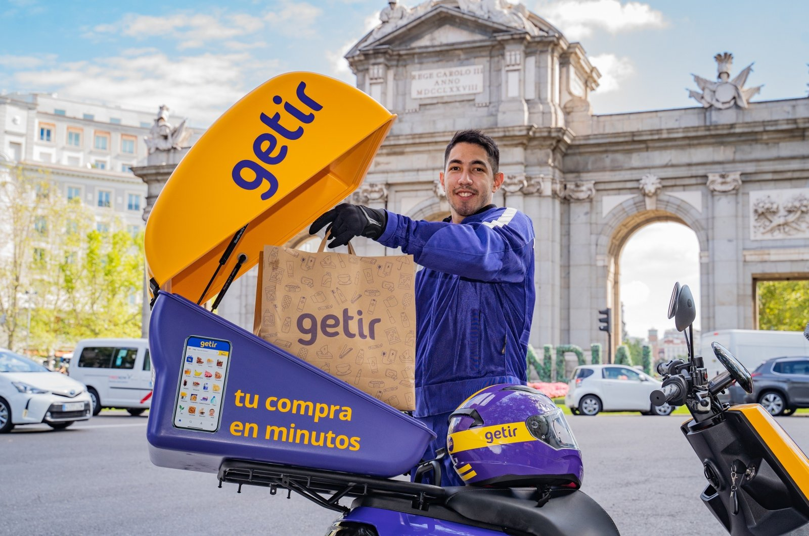A delivery man poses in Madrid as Spain becomes the sixth in Getir's growing list of countries where it offers on-demand delivery service, Spain, Sept. 15, 2021. (IHA Photo)
