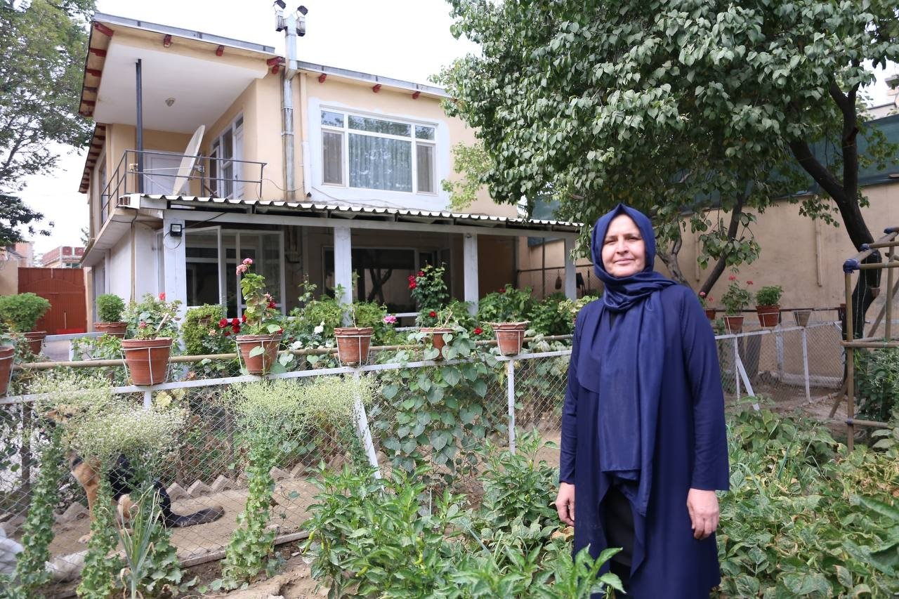 Fatma poses outside her home in Kabul, Afghanistan, Sept. 14, 2021. (AA PHOTO)