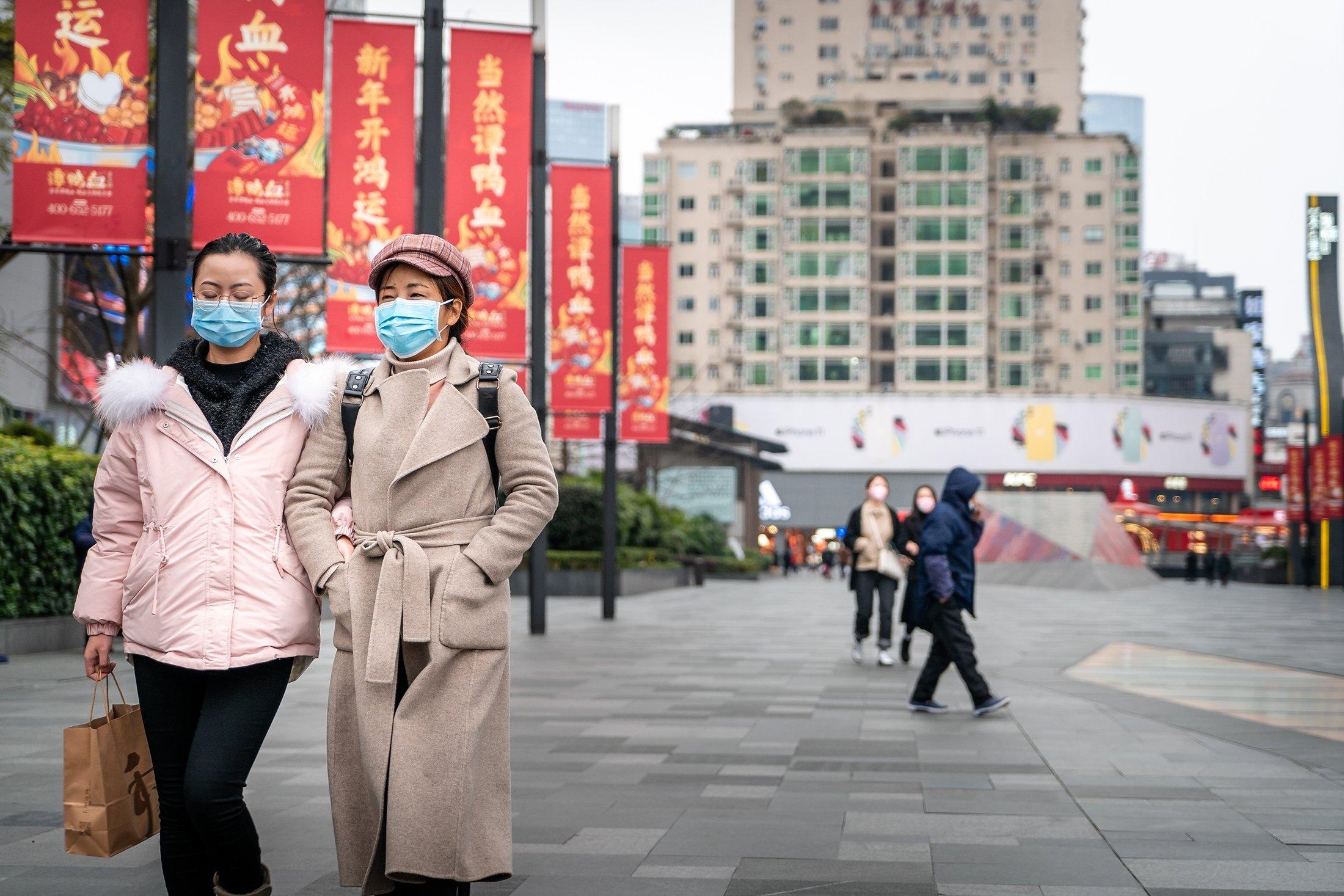 People wearing masks walking in Chengdu, China, Jan. 23, 2020. (Shutterstock Photo)