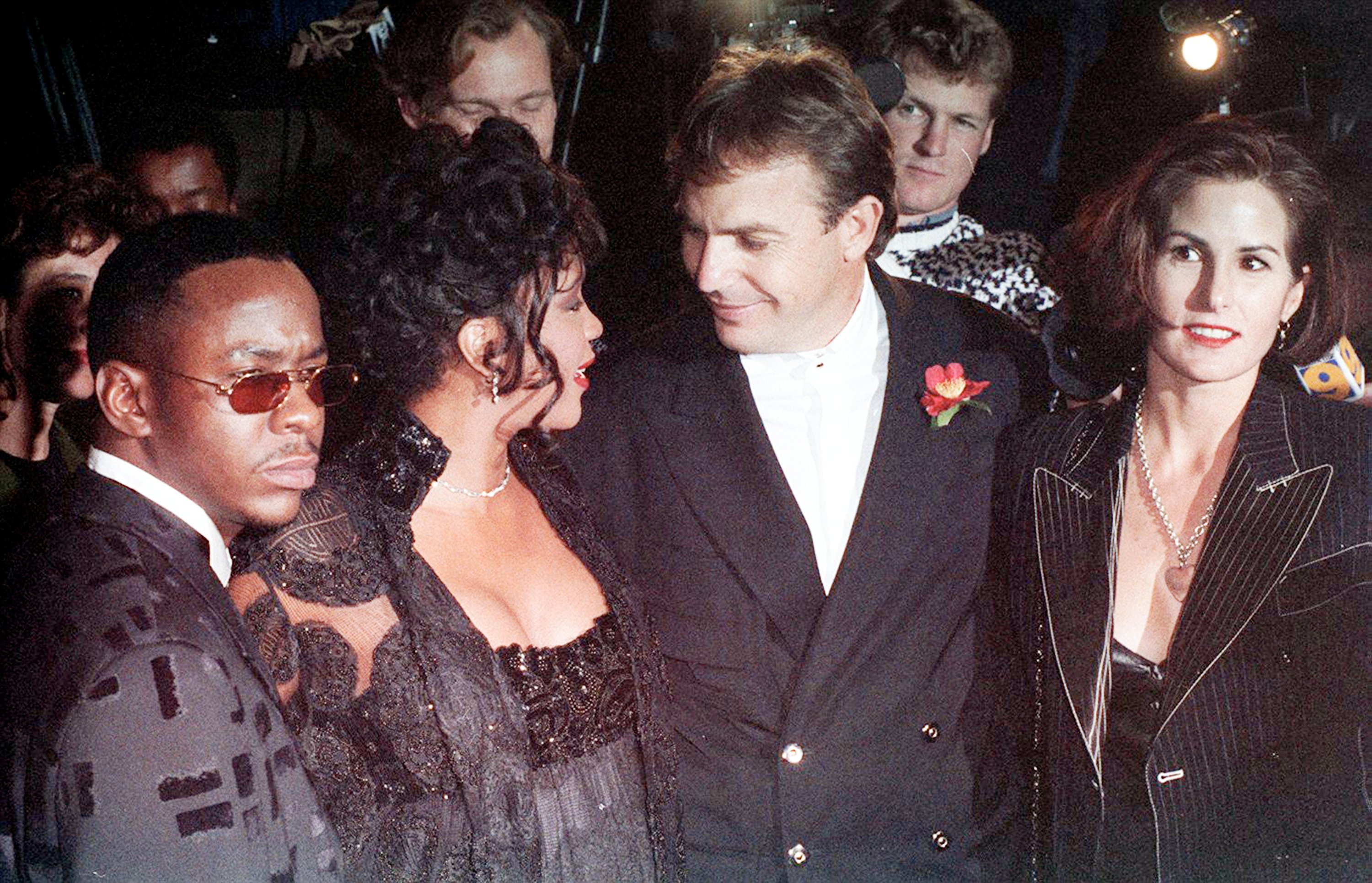 Singers Bobby Brown and Whitney Houston, and actor Kevin Costner with his wife Cindy Costner attend 'The Bodyguard' Hollywood premiere at Mann's Chinese Theatre in Hollywood, California, U.S., Nov. 23, 1992.  (Getty Images)