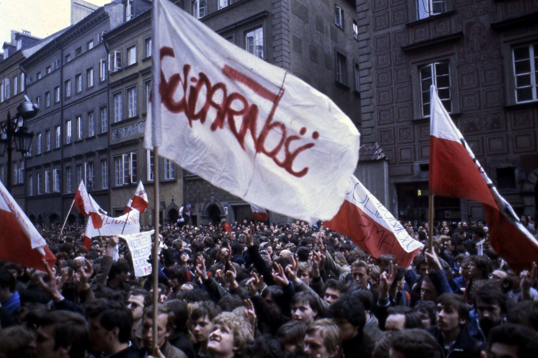 Thousands of Solidarity protestors take to the streets in the worst disturbances to affect the capital since the imposition of martial law as squads of Polish riot police are moved into the vicinity of Warsaw's Castle Square, Poland, May 3, 1982. (AP Photo)