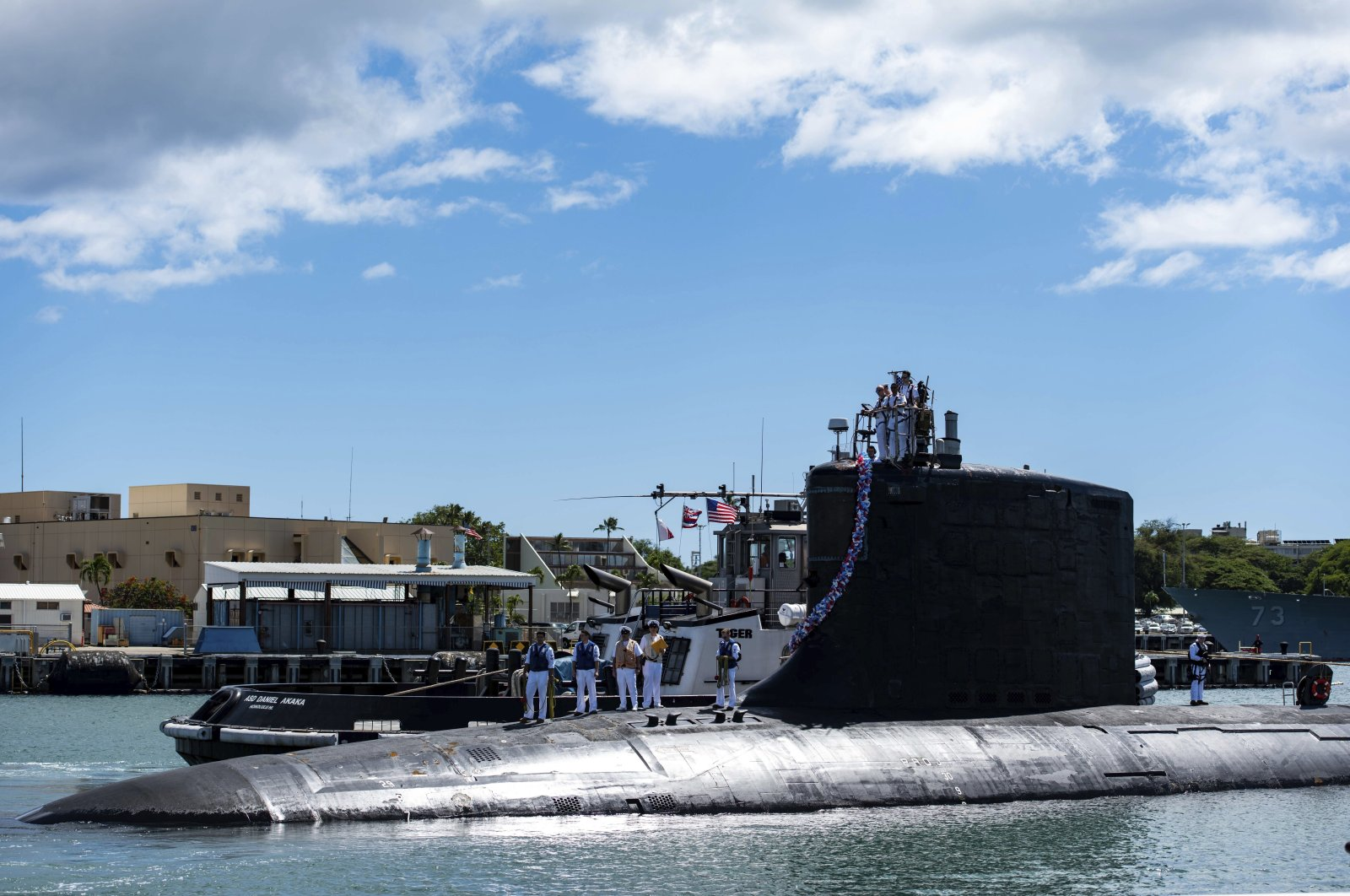 The Virginia-class fast-attack submarine USS Illinois (SSN 786) returns from a deployment in the 7th Fleet area of responsibility to Joint Base Pearl Harbor-Hickam, Hawaii, U.S., on Sept. 13, 2021. (AP Photo)