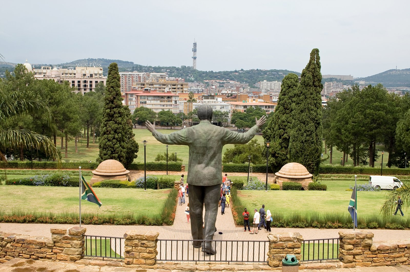 People take images of the nine-meter-tall bronze statue of former president Nelson Mandela of South Africa at the Union buildings in Pretoria, South Africa, March 22, 2015. (Shutterstock Photo)