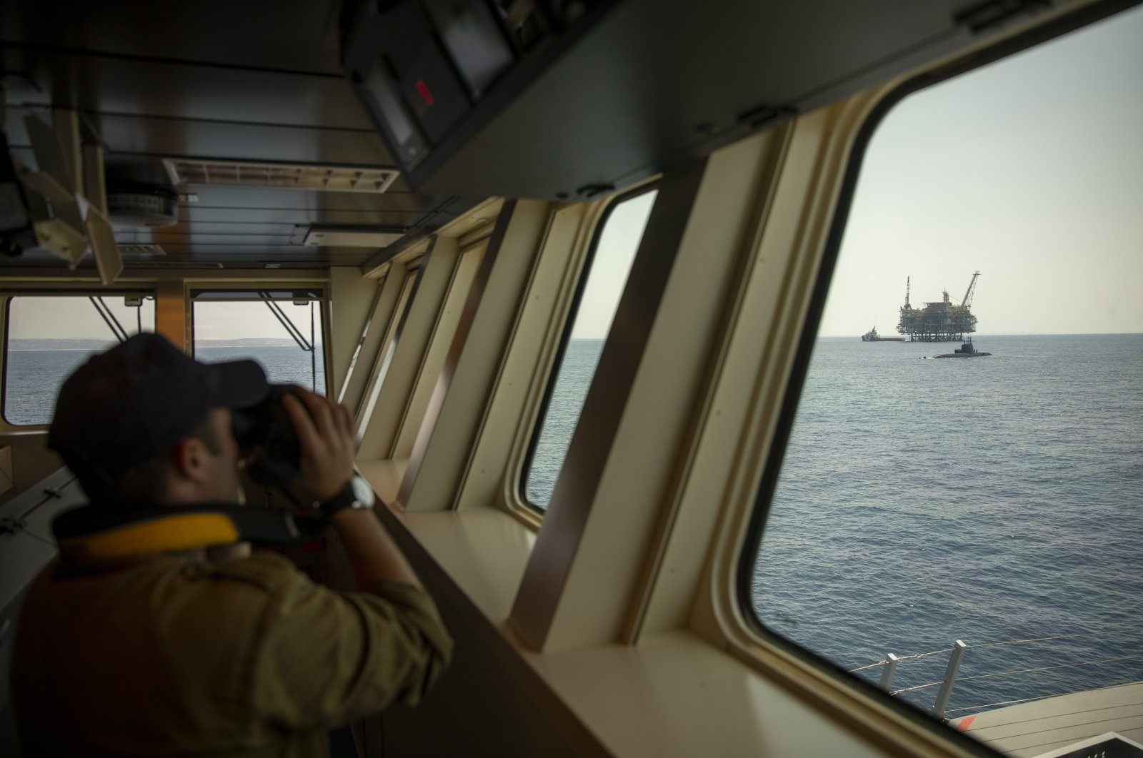 An Israeli Navy sailor looks at Israel's offshore Leviathan gas field from on board the Israeli Navy Ship Atzmaut as a submarine patrols in the Mediterranean Sea, Sept. 1, 2021. (AP Photo)