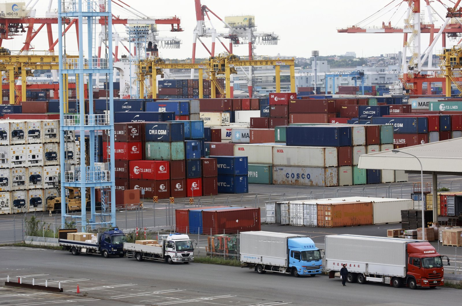 Containers are placed at a port in Yokohama, south of Tokyo, Japan, Sept. 7, 2021. (AP Photo)