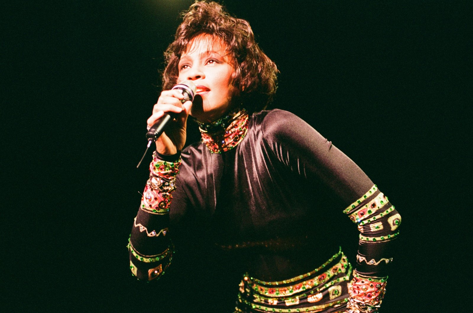 """Whitney Houston performs at a concert in Earls Court Exhibition Center as part of """"The Bodyguard World Tour,"""" London, Nov. 5, 1993. (Getty Images)"""