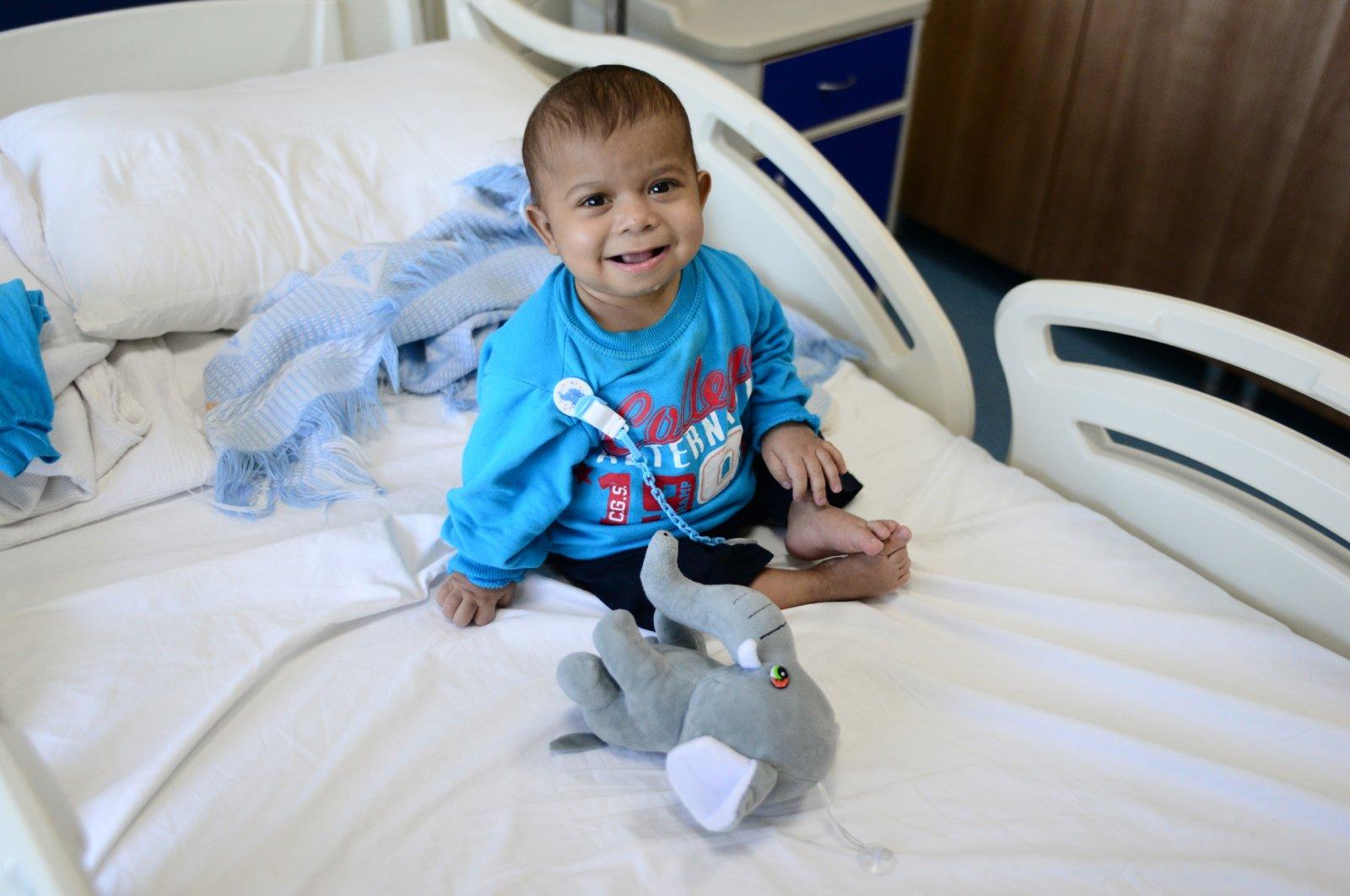 Tamar al-Jadou sits on his hospital bed, in Bursa, northwestern Turkey, Sept. 15, 2021. (DHA Photo)