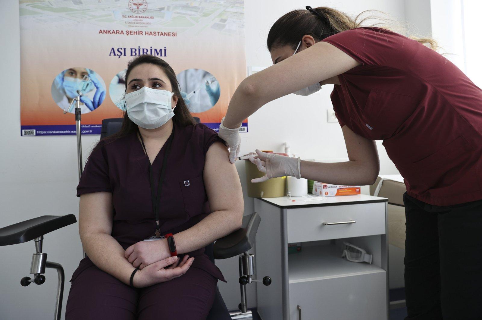A health care worker gets vaccinated with CoronaVac, in the capital Ankara, Turkey, Jan. 20, 2021. (AA PHOTO)