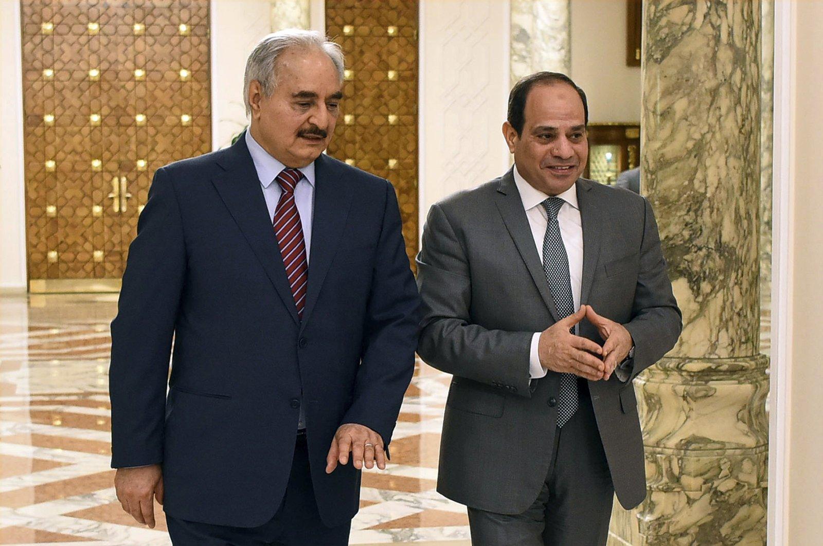 Egyptian President Abdel-Fattah el-Sissi, right, walks with putschist Gen. Khalifa Haftar in Cairo, Egypt, May 9, 2019. (Egyptian Presidency Media office via AP)