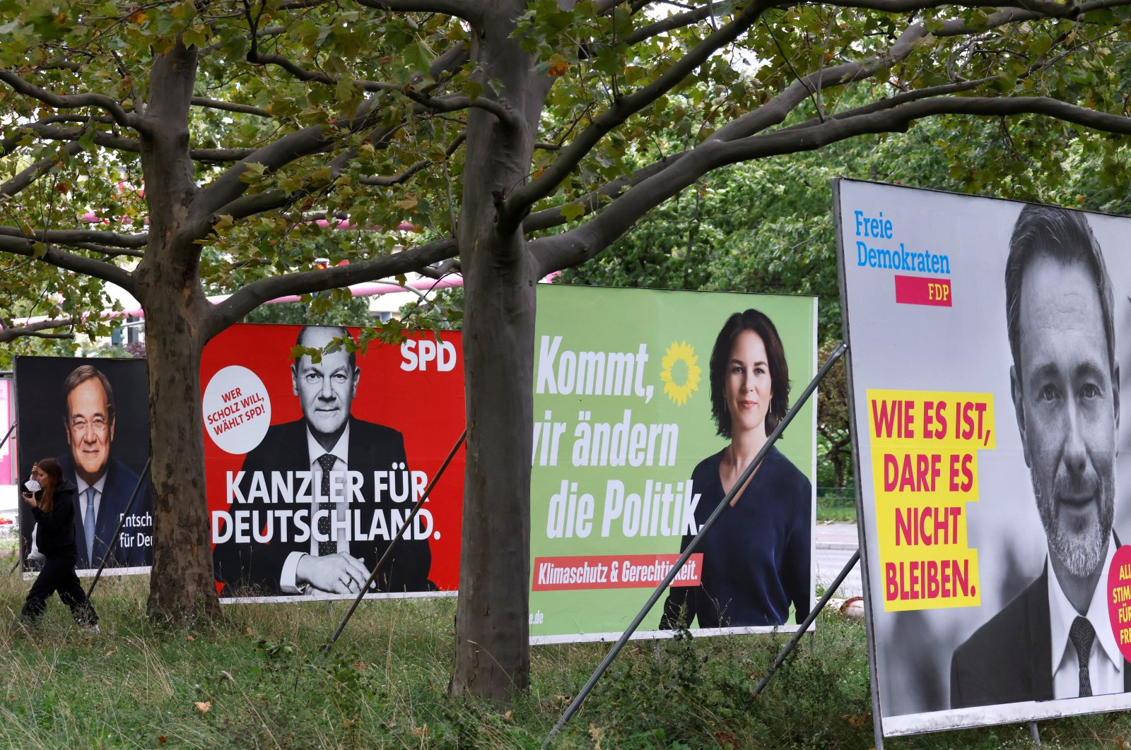 (L-R) Election posters of Germany's top candidates for chancellor, Armin Laschet, North Rhine-Westphalia's State Premier and Christian Democratic Union (CDU) leader; Olaf Scholz, German minister of finance of the Social Democratic Party (SPD); Annalena Baerbock, co-leader of Germany's Green party and Christian Lindner, leader of the Free Democratic Party of Germany (FDP) are pictured, in Berlin, Germany, Sept. 16, 2021. (Reuters Photo)