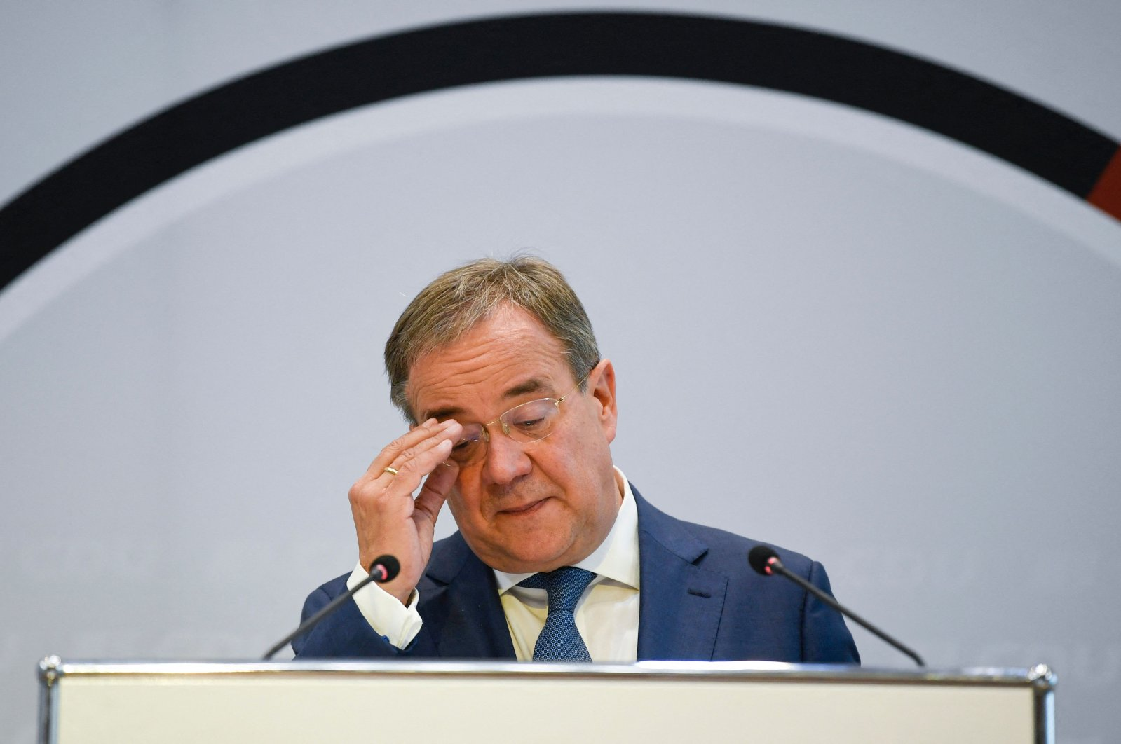 North Rhine-Westphalia's State Premier Armin Laschet, leader of the conservative Christian Democratic Union (CDU) and candidate for chancellor, fixes his glasses at a press conference in Stuttgart, southern Germany, Sept. 15, 2021. (AFP Photo)