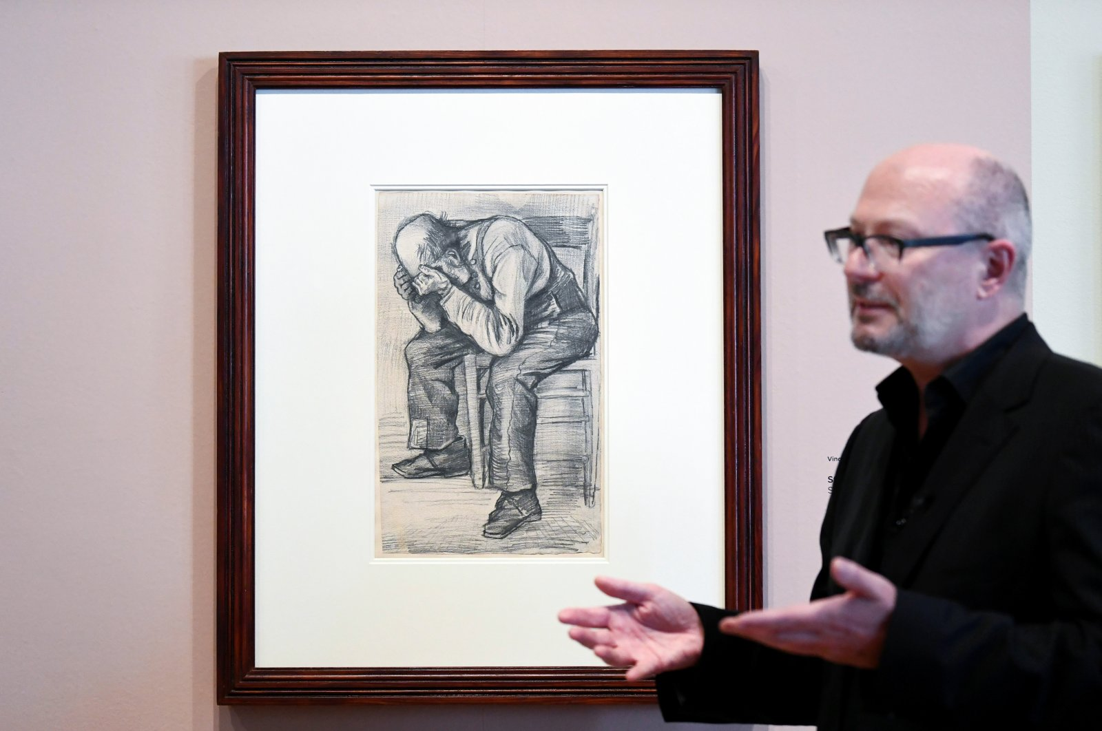 """Senior researcher Teio Meenendorp unveils the unseen artwork by Vincent van Gogh that is named """"Worn Out"""" at The Van Gogh Museum in Amsterdam, Netherlands, Sept. 16, 2021. (Reuters Photo)"""