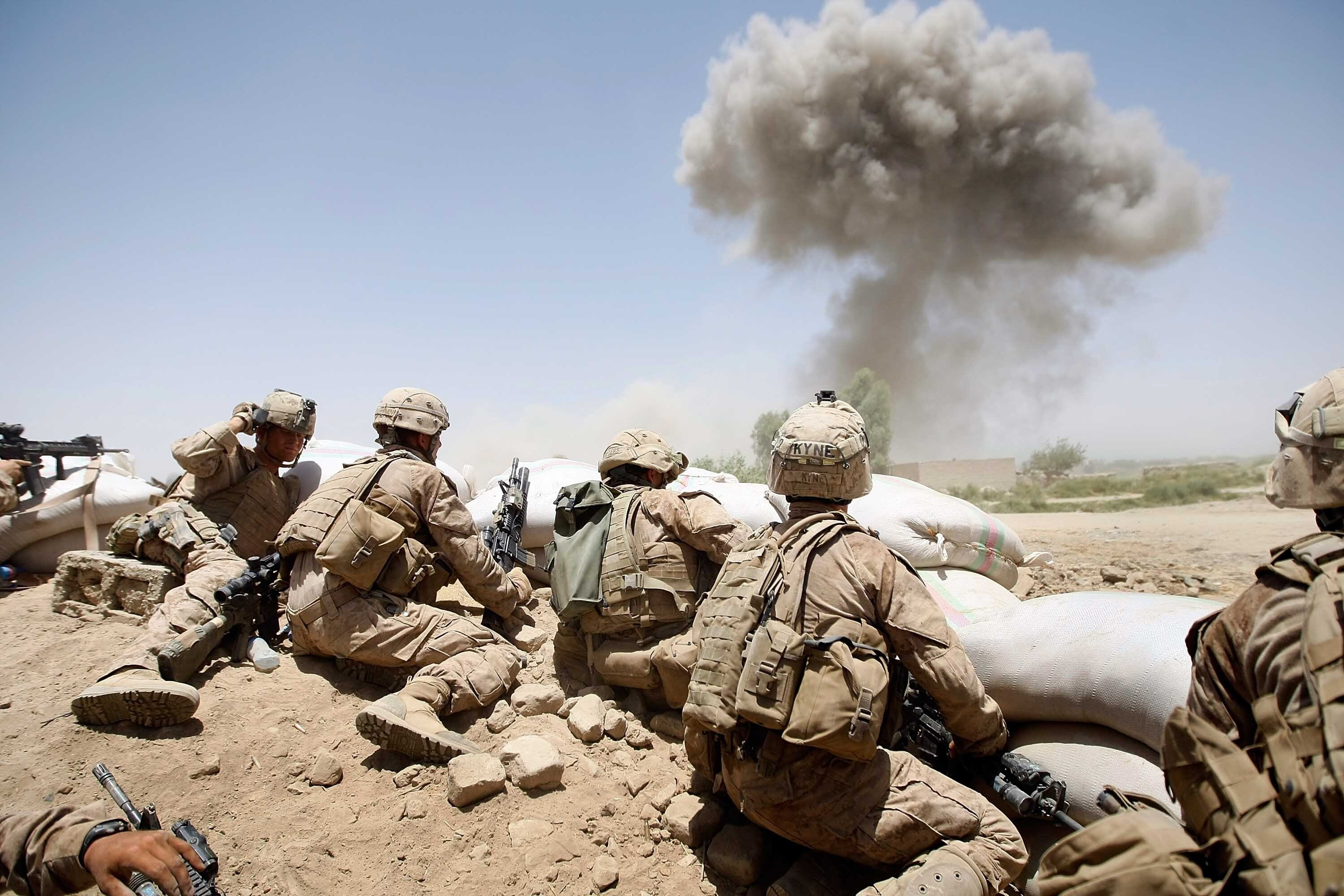 U.S. Marines from the 2nd Marine Expeditionary Brigade, RCT 2nd Battalion 8th Marines Echo Co. take cover, in Main Poshteh, Afghanistan, July 3, 2009. (Getty Images)