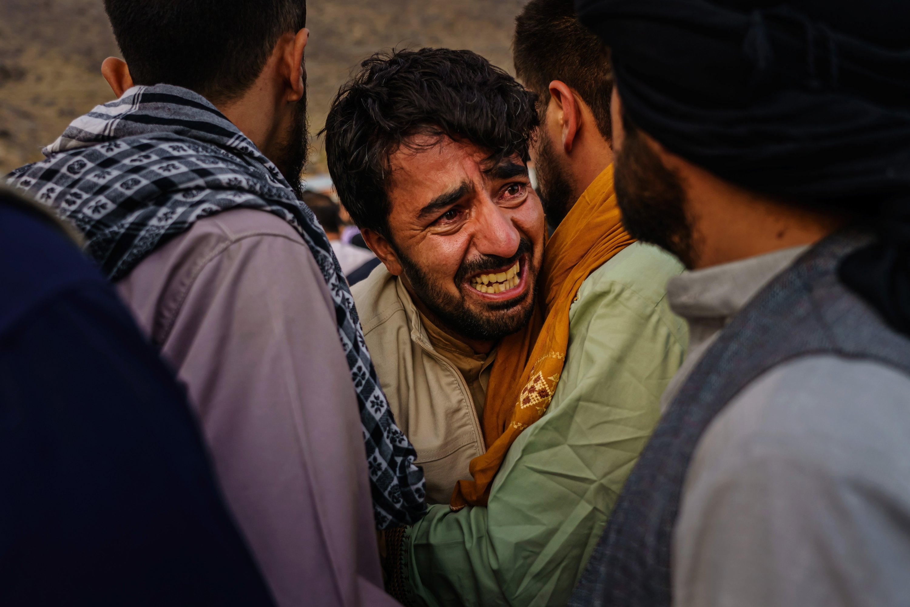 A man grieves during a mass funeral for members of a family was killed in a U.S. drone airstrike, in Kabul, Afghanistan, Aug. 30, 2021. (Getty Images)