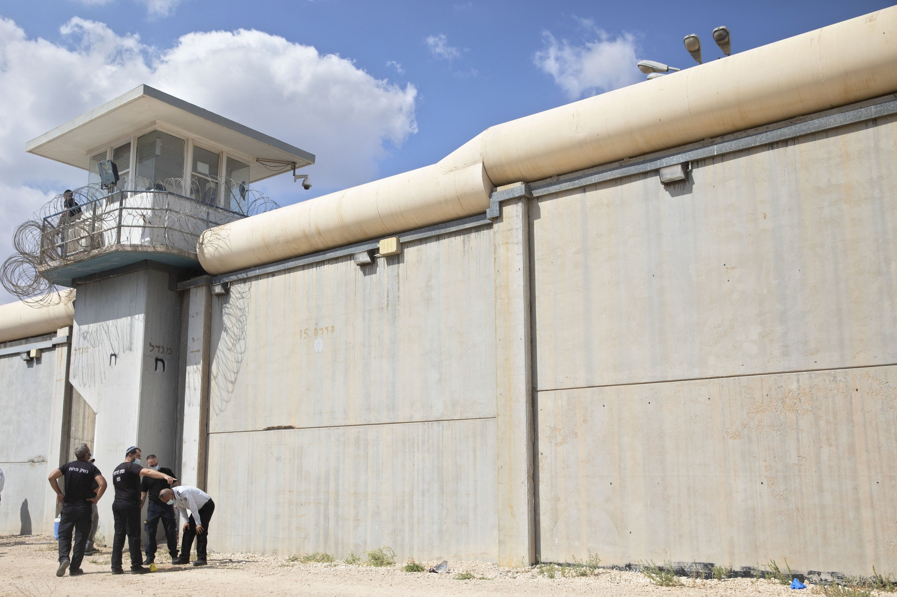 Police officers and prison guards inspect the scene of a prison escape outside the Gilboa prison in northern Israel, Monday, Sept. 6, 2021. (AP Photo)