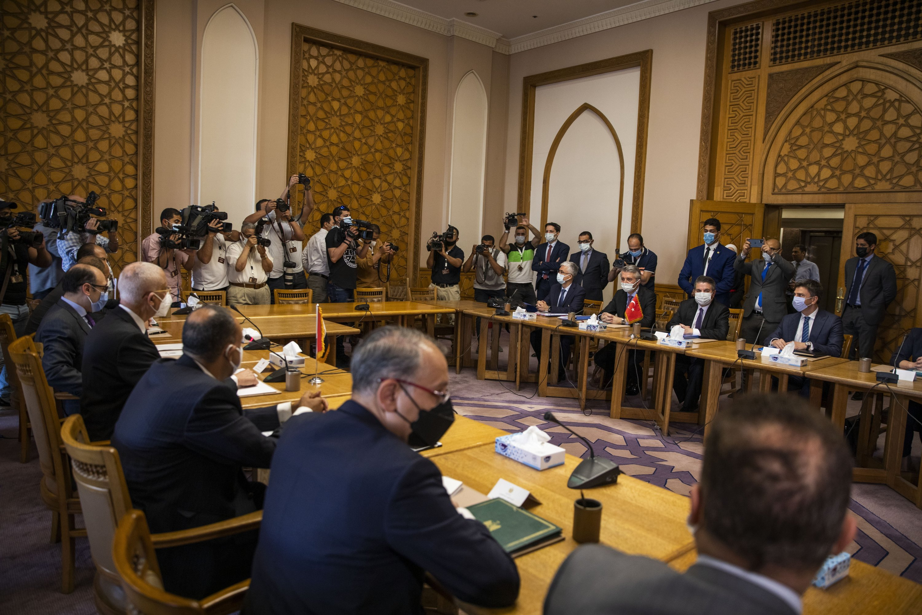 Turkish Foreign Ministry Deputy Sedat Onal, seated (2-R), meets with Hamdi Sanad Loza, Egyptian deputy foreign minister, (4-L), and their delegations, at the Foreign Ministry in Cairo, Egypt, May 5, 2021. (AP Photo)