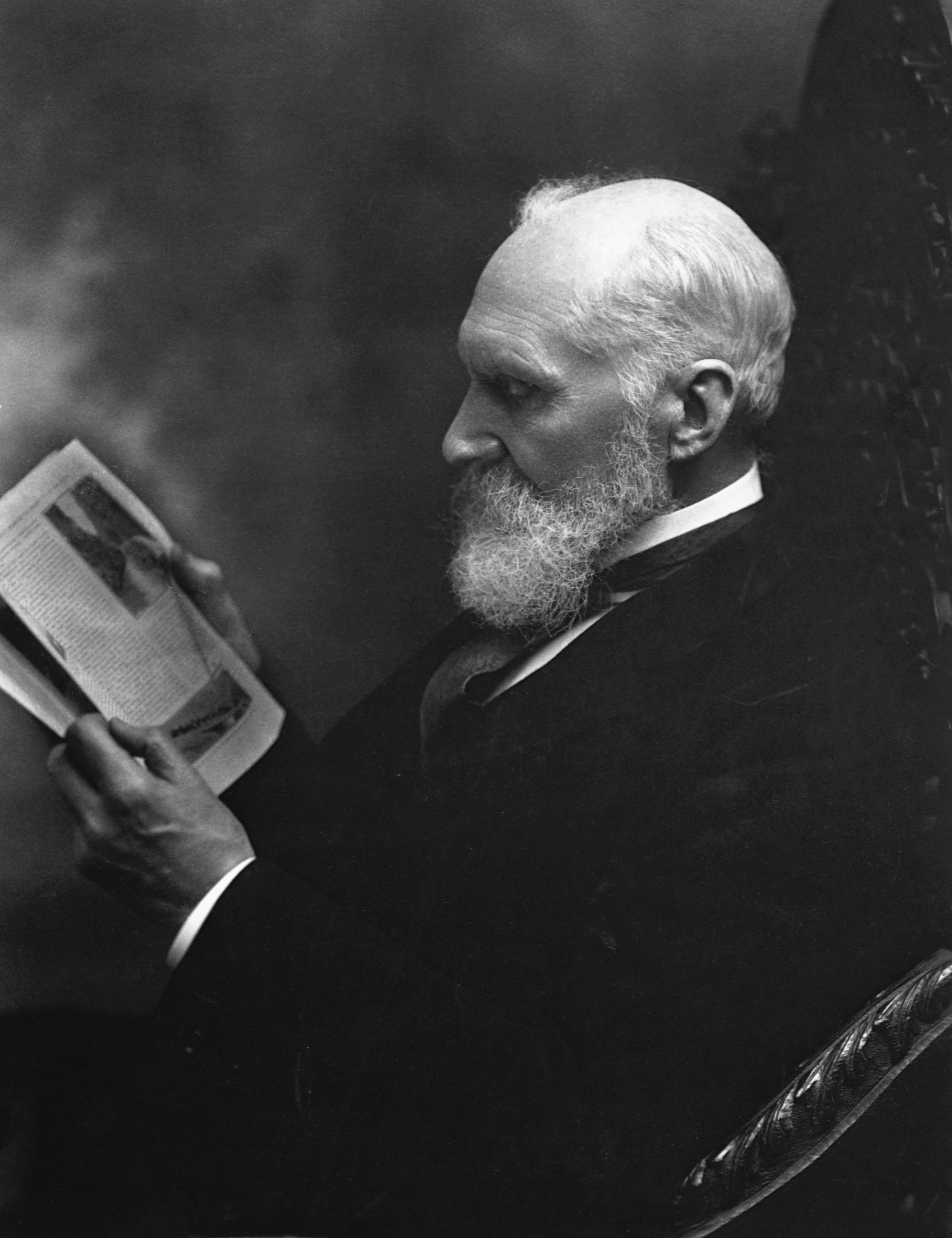 William Thomson, 1st Baron Kelvin sits reading a paper. (Getty Images)