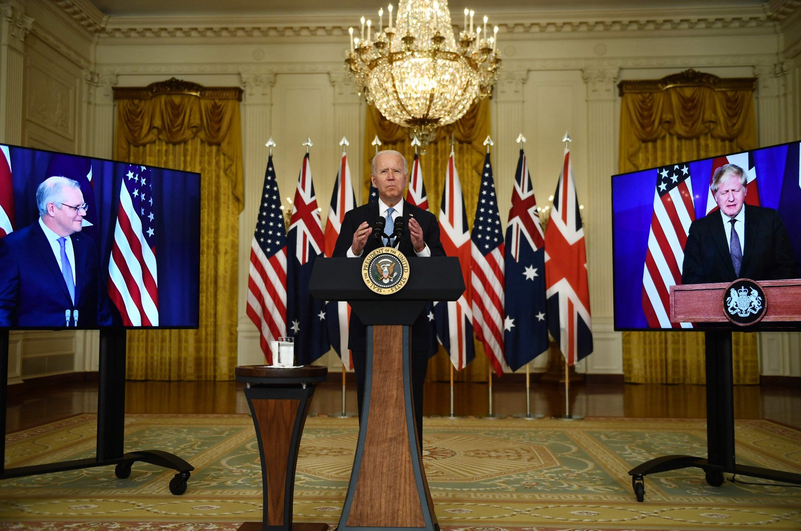 U.S. President Joe Biden, joined virtually by Australian Prime Minister Scott Morrison (R) and British Prime Minister Boris Johnson, speaks about a national security initiative from the East Room of the White House in Washington, Sept. 15, 2021. (AFP Photo)