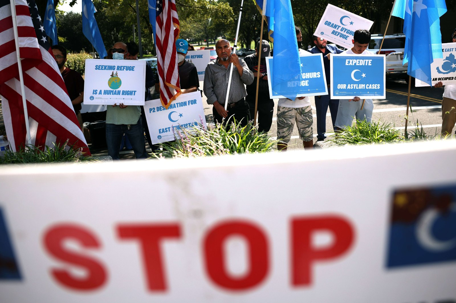 Signs are seen as members of the Uyghurs community, a mainly Muslim ethnic group originating from central and east Asia, rally against the Chinese government at the U.S. State Department, Washington, D.C., U.S., Sept. 15, 2021. (Getty Images/AFP)