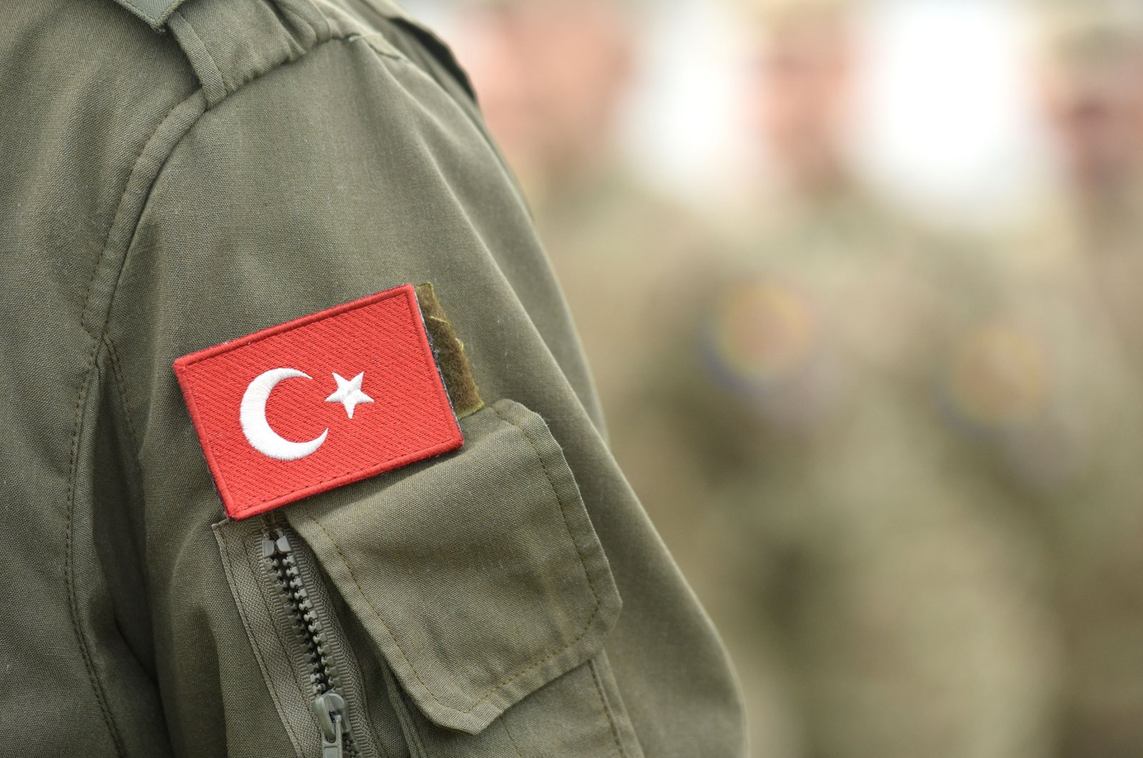The Turkish flag is seen on the uniform of a Turkish army soldier. (Shutterstock Photo)