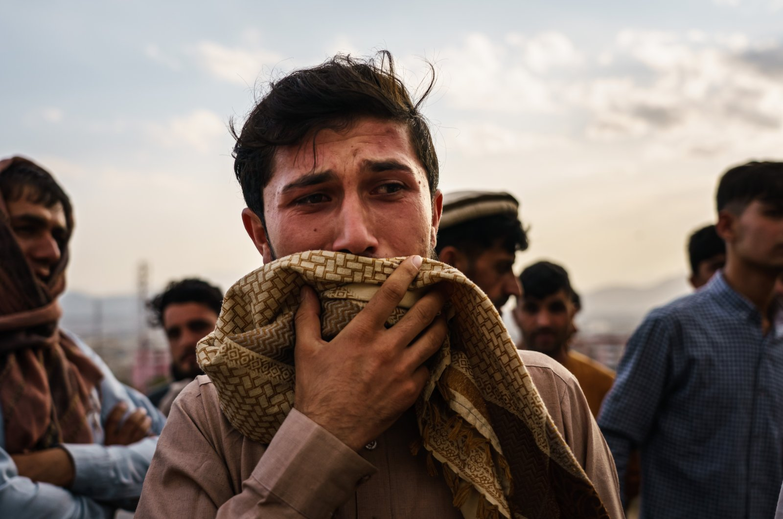 A man weeps during a mass funeral for a members of a family was killed in a U.S. drone airstrike, in Kabul, Afghanistan, Aug. 30, 2021. (Getty Images)