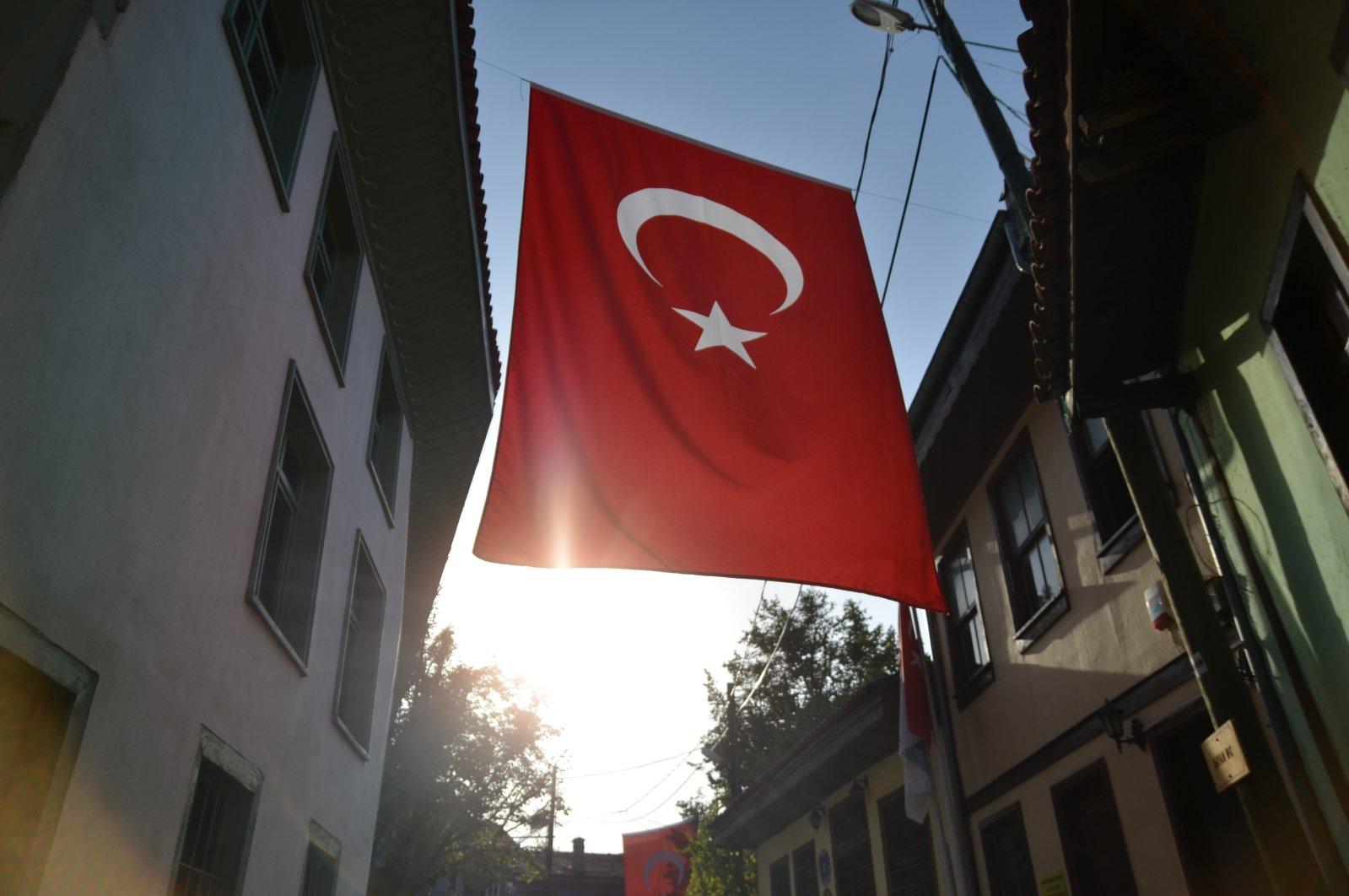 Turkish flag hangs between two buildings. (Shutterstock Photo)