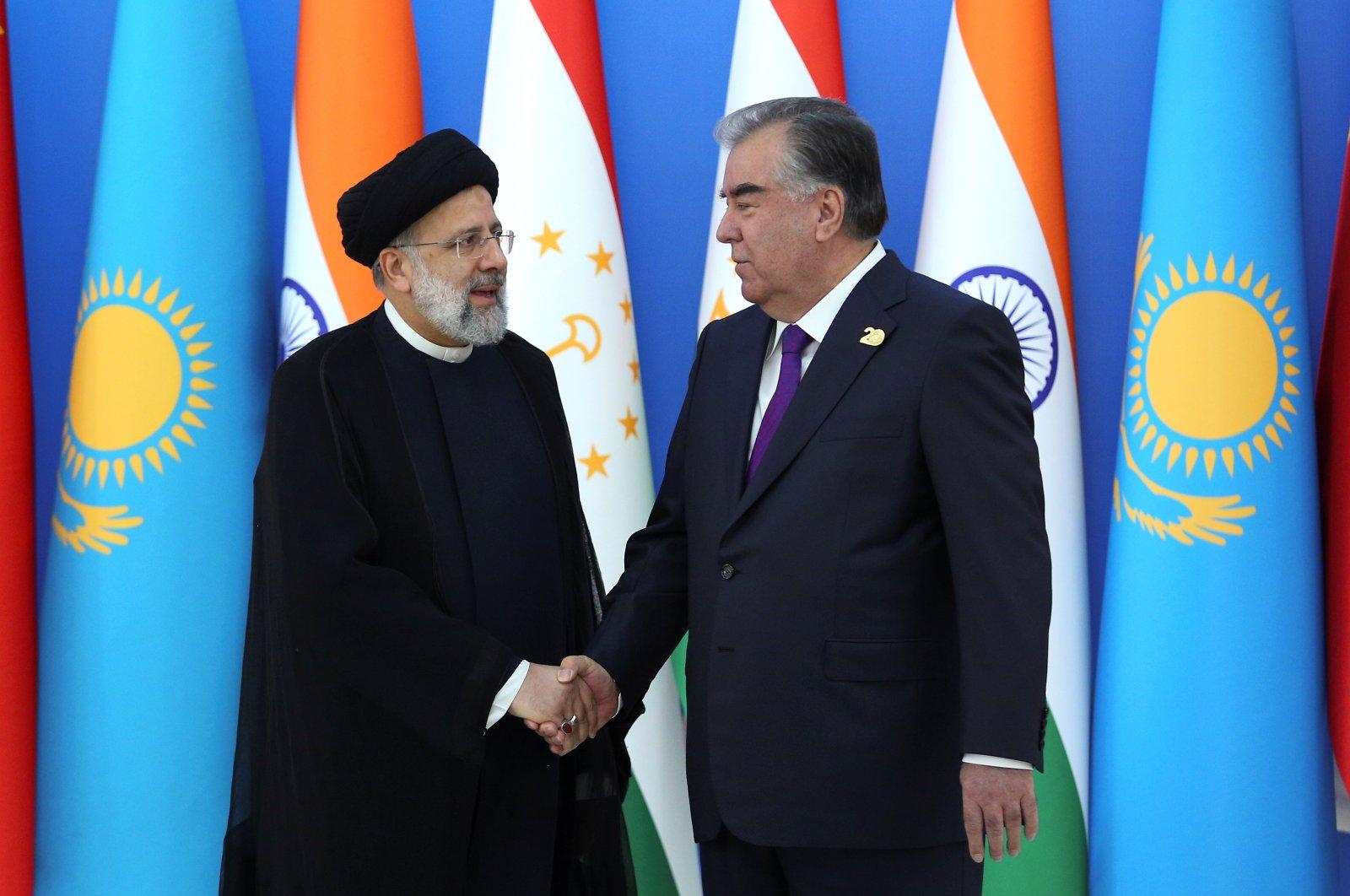 Tajik President Emomali Rakhmon shakes hands with Iranian President Ebrahim Raisi during the Shanghai Cooperation Organization (SCO) summit in Dushanbe, Tajikistan, Sept. 17, 2021. (Reuters Photo)