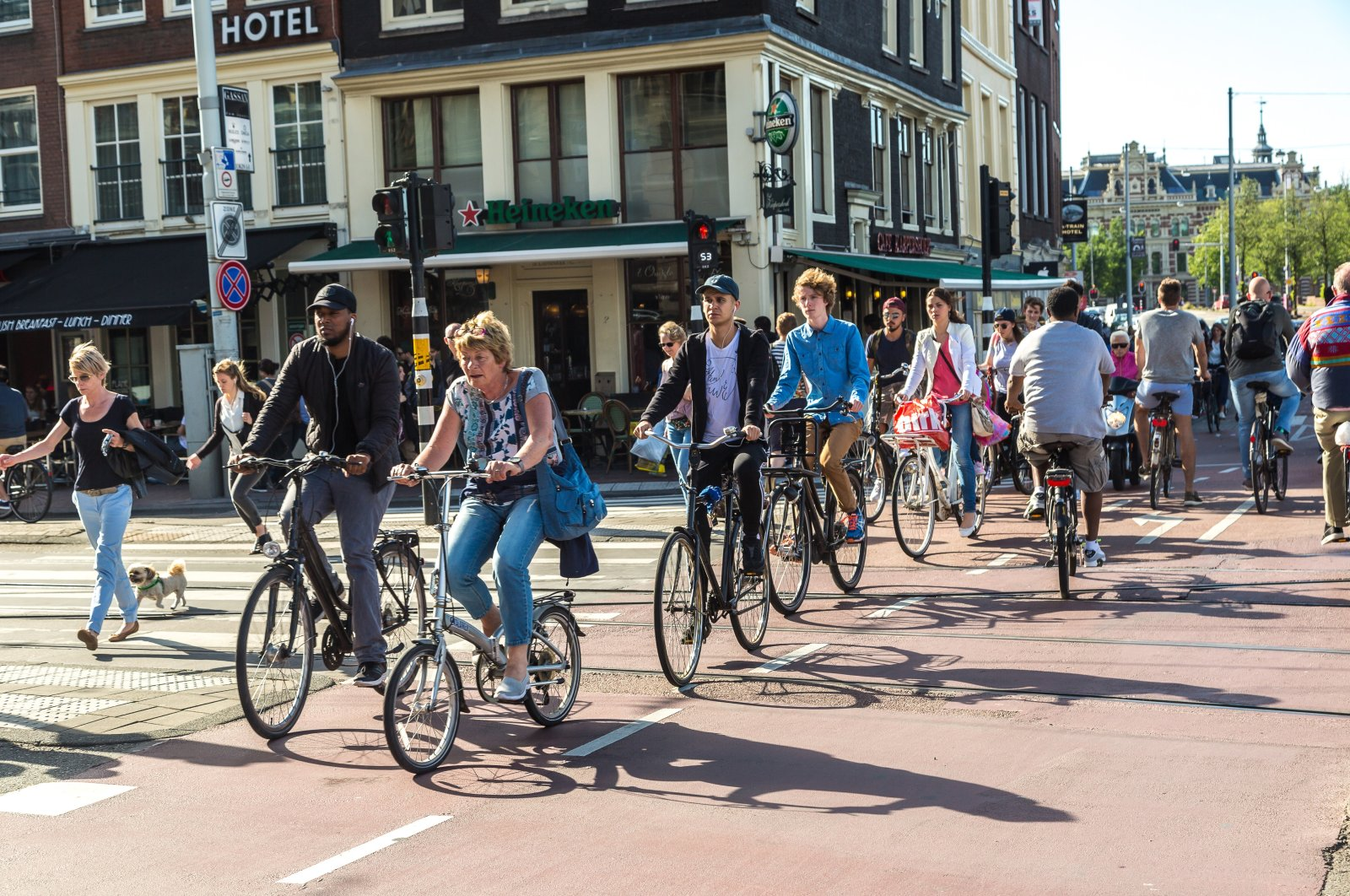 People riding bicycles in a historical part of Amsterdam, The Netherlands, June 16, 2016. (Shutterstock Photo)