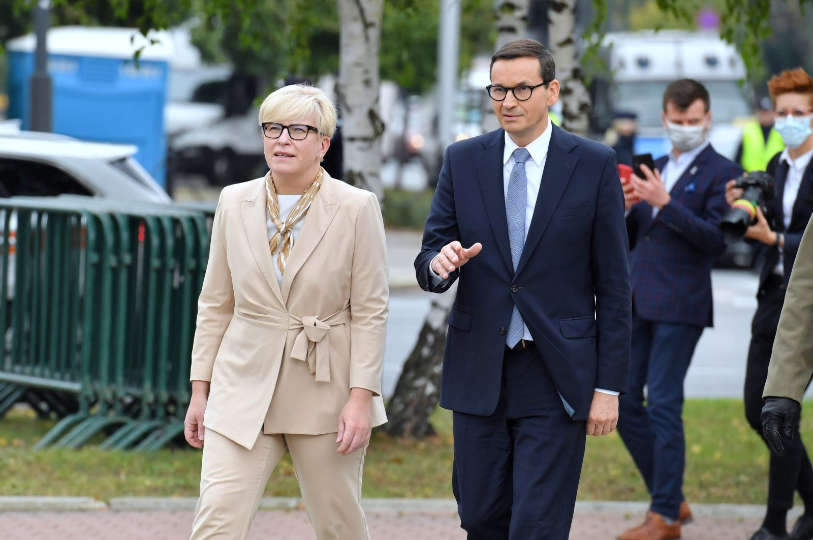 Poland's Prime Minister Mateusz Morawiecki (R) and Prime Minister of the Republic of Lithuania Ingrida Simonyte (L) walk in front of the Monument to the Fallen and Murdered in the East, in Warsaw, Poland, Sept. 17, 2021. (EPA Photo)
