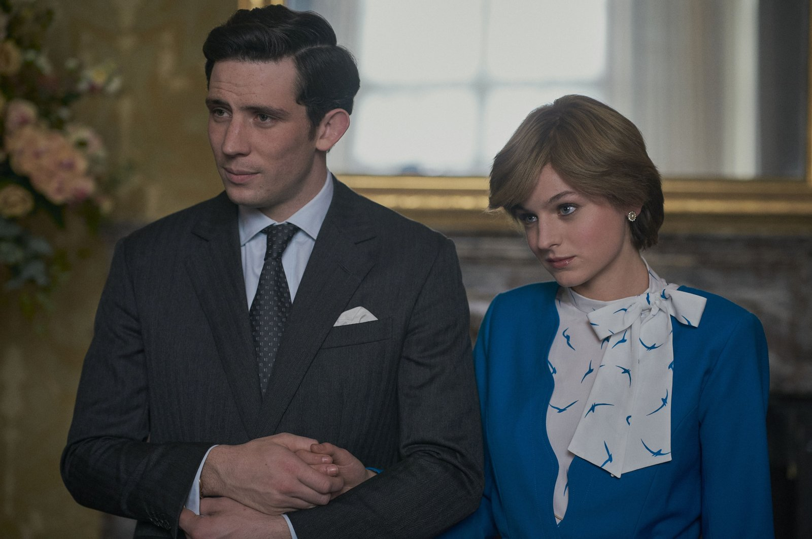 """This image released by Netflix shows Josh O'Connor (L) and Emma Corrin in a scene from """"The Crown."""" (AP Photo)"""