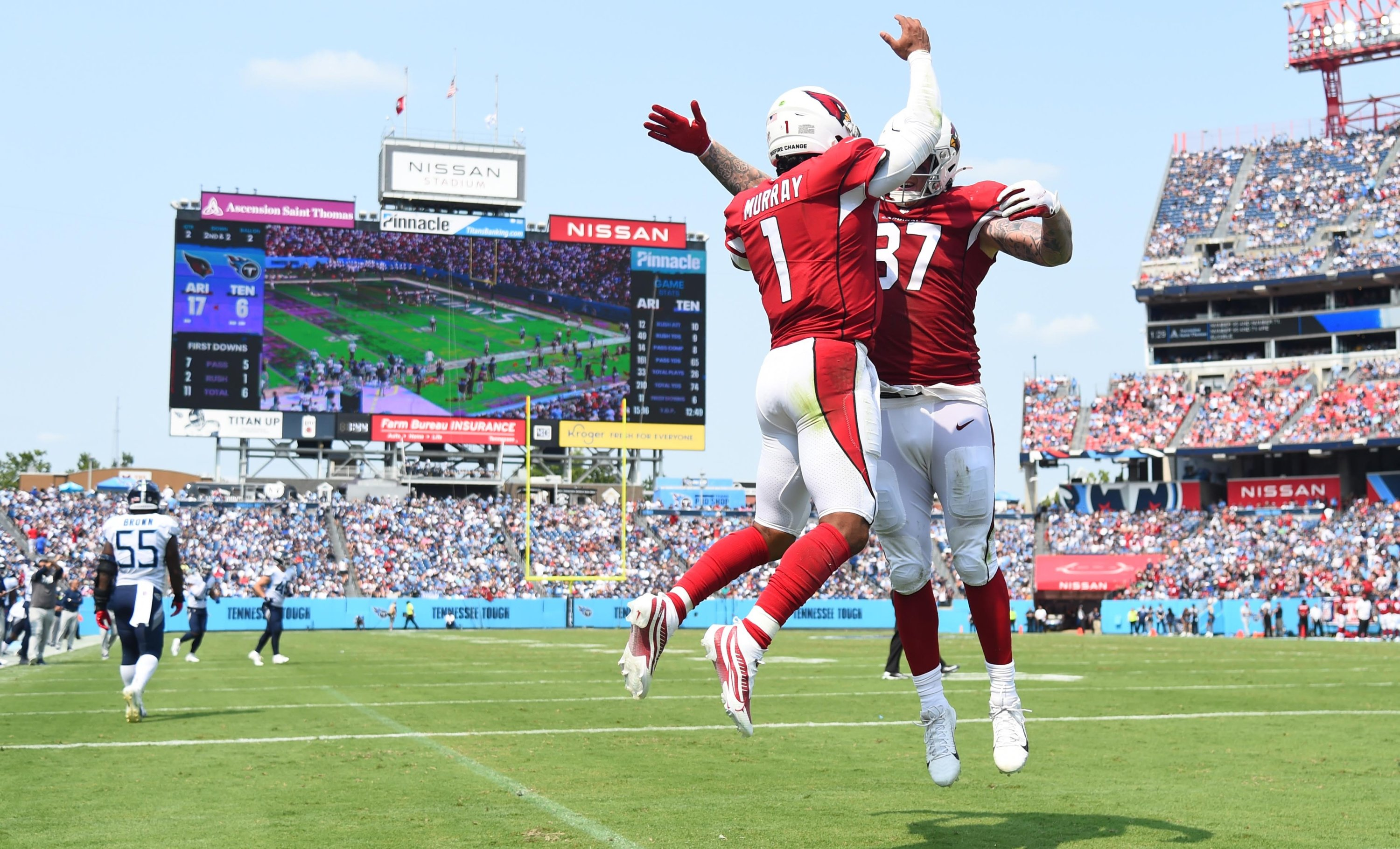 Arizona Cardinals quarterback Kyler Murray (1) celebrates with Arizona Cardinals tight end Maxx Williams (87) after a touchdown run during the first half against the Tennessee Titans at Nissan Stadium, Nashville, Tennessee, U.S., Sept. 12, 2021. (Christopher Hanewinckel-USA TODAY Sports via REUTERS)