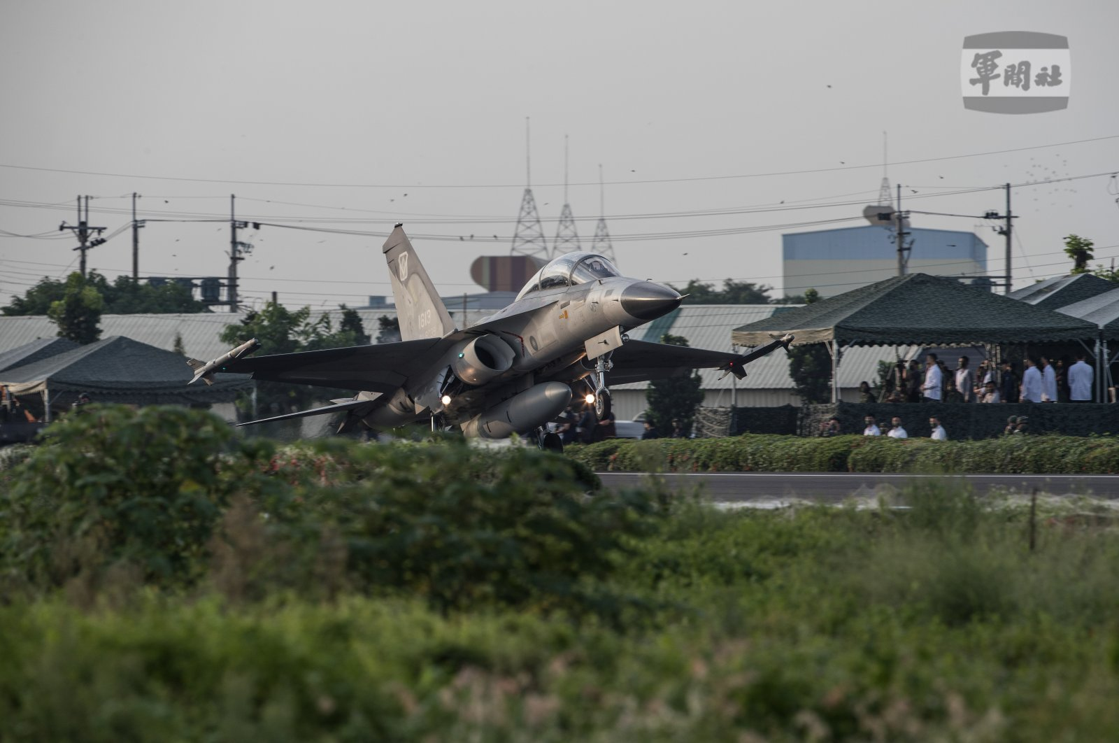 A handout photo made available by the Taiwan Ministry of National Defense shows a Taiwanese Air Force IDF fighter jet take-off on a highway converted as a runway during the Emergency Take-off and Landing drill in Pingtung, Taiwan, Sept. 15, 2021. (EPA Photo)