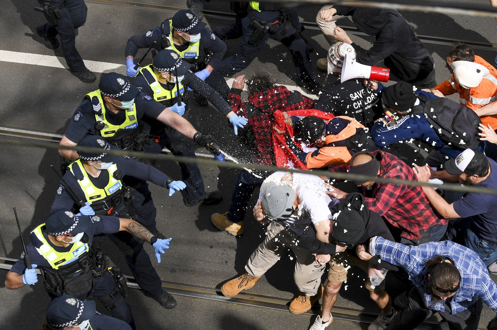 Victoria police fire pepper spray during a clash with protesters at a Rally for Freedom in Melbourne, Australia, Sept. 18, 2021. (AAP Image via AP)