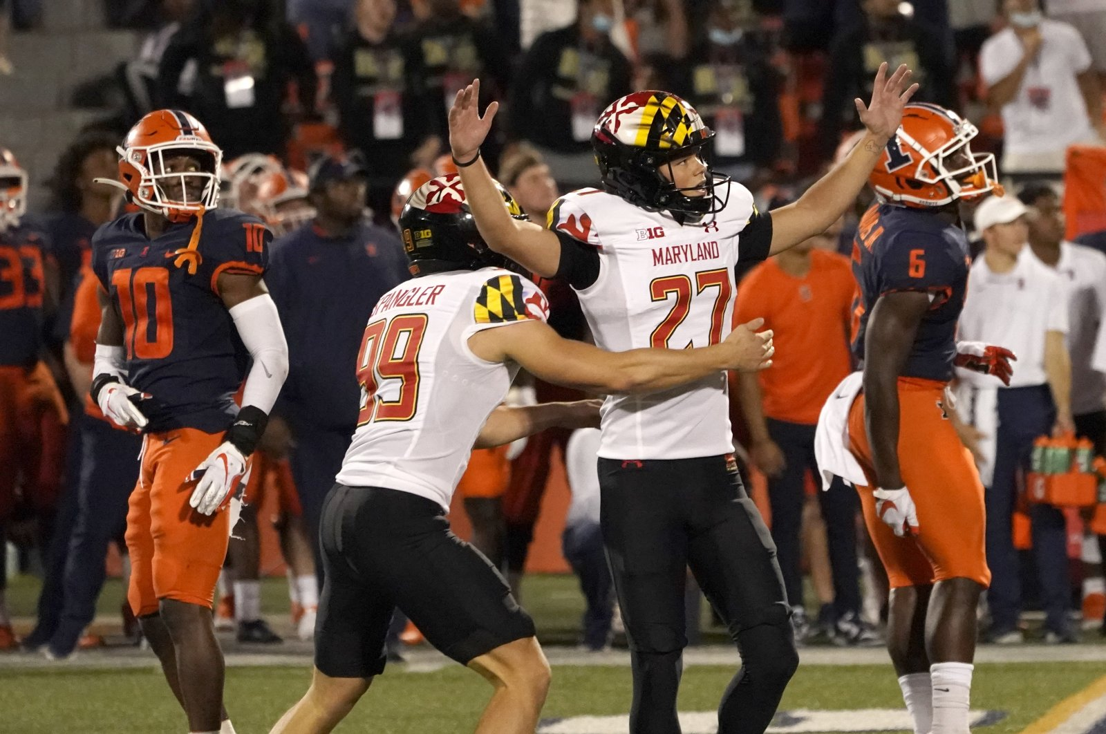 Maryland's Joseph Petrino celebrates his game-winning field goal with holder Colton Spangler during the second half of the team's college football game against Illinois at Memorial Stadium, Champaign, Illinois, U.S., Sept. 17, 2021. (AP Photo)