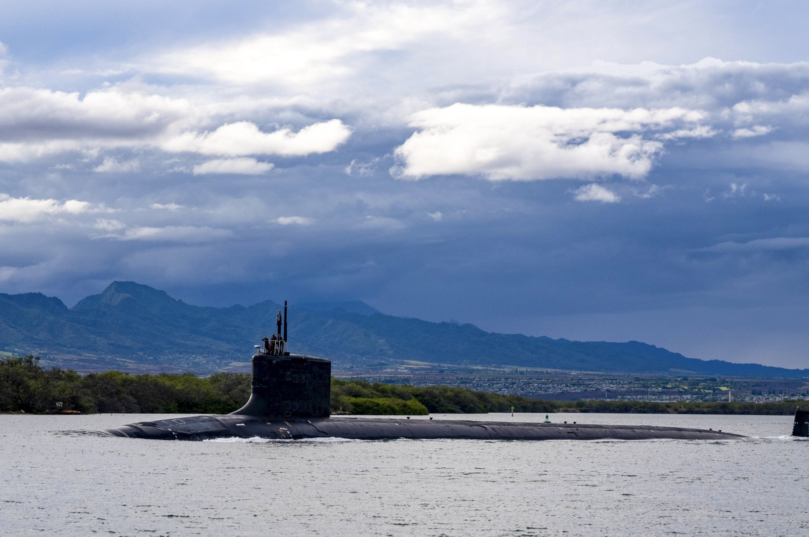 In this photo provided by U.S. Navy, the Virginia-class fast-attack submarine USS Missouri (SSN 780) departs Joint Base Pearl Harbor-Hickam for a scheduled deployment in the 7th Fleet area of responsibility, Sept. 1, 2021. (AP Photo)