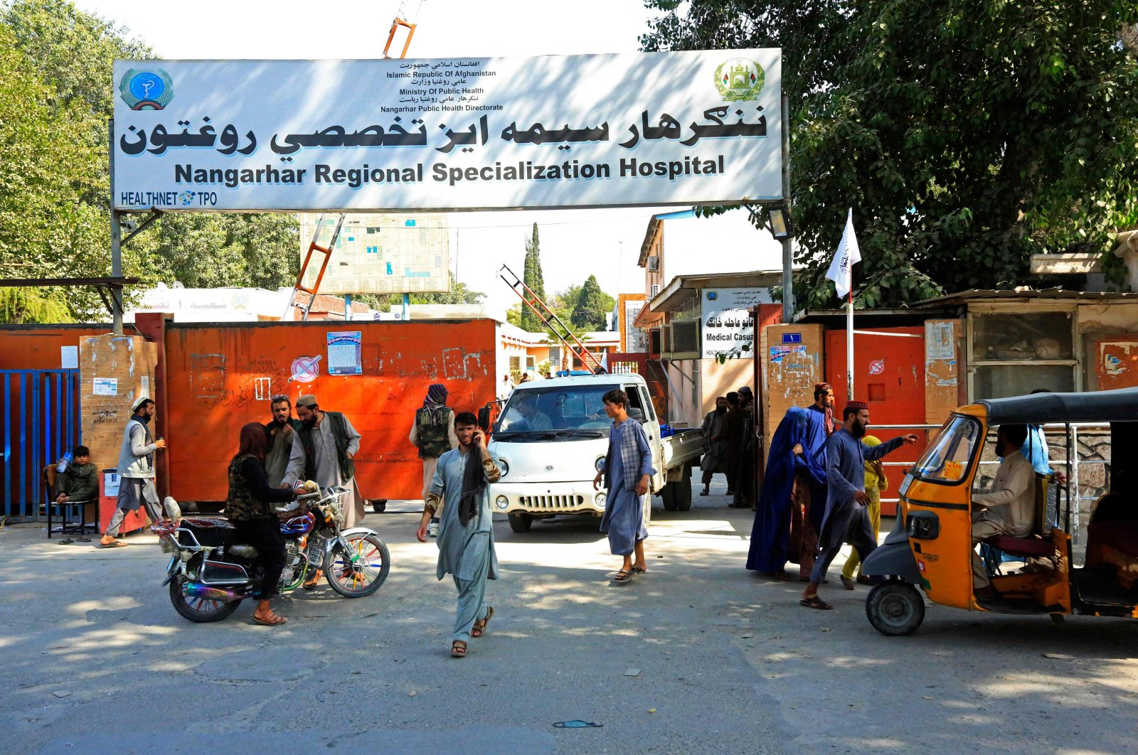 People stand outside the Nangarhar Regional Specialization Hospital after explosions in Jalalabad, Afghanistan, Sept. 18, 2021. (AFP Photo)